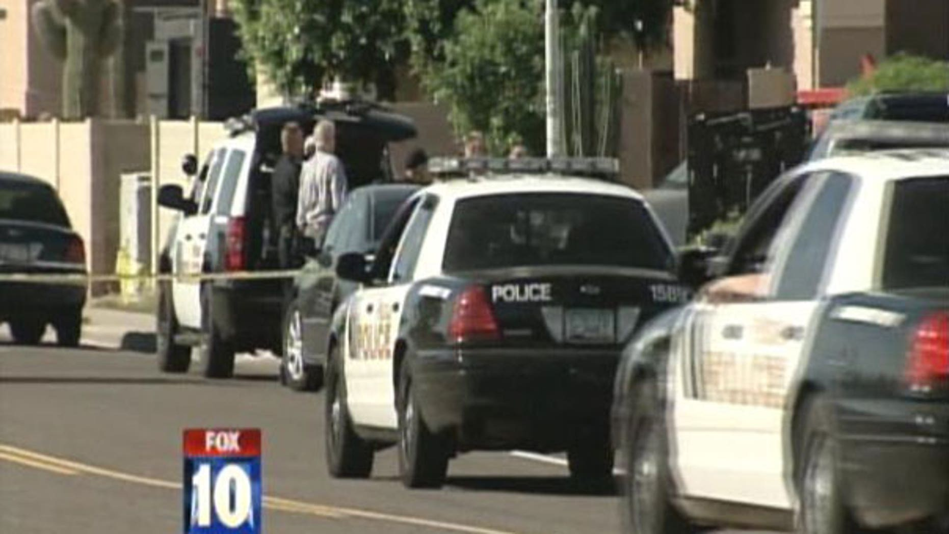 April 20: Police surround a house in Peoria, Arizona while searching for suspects in a reported home invasion.