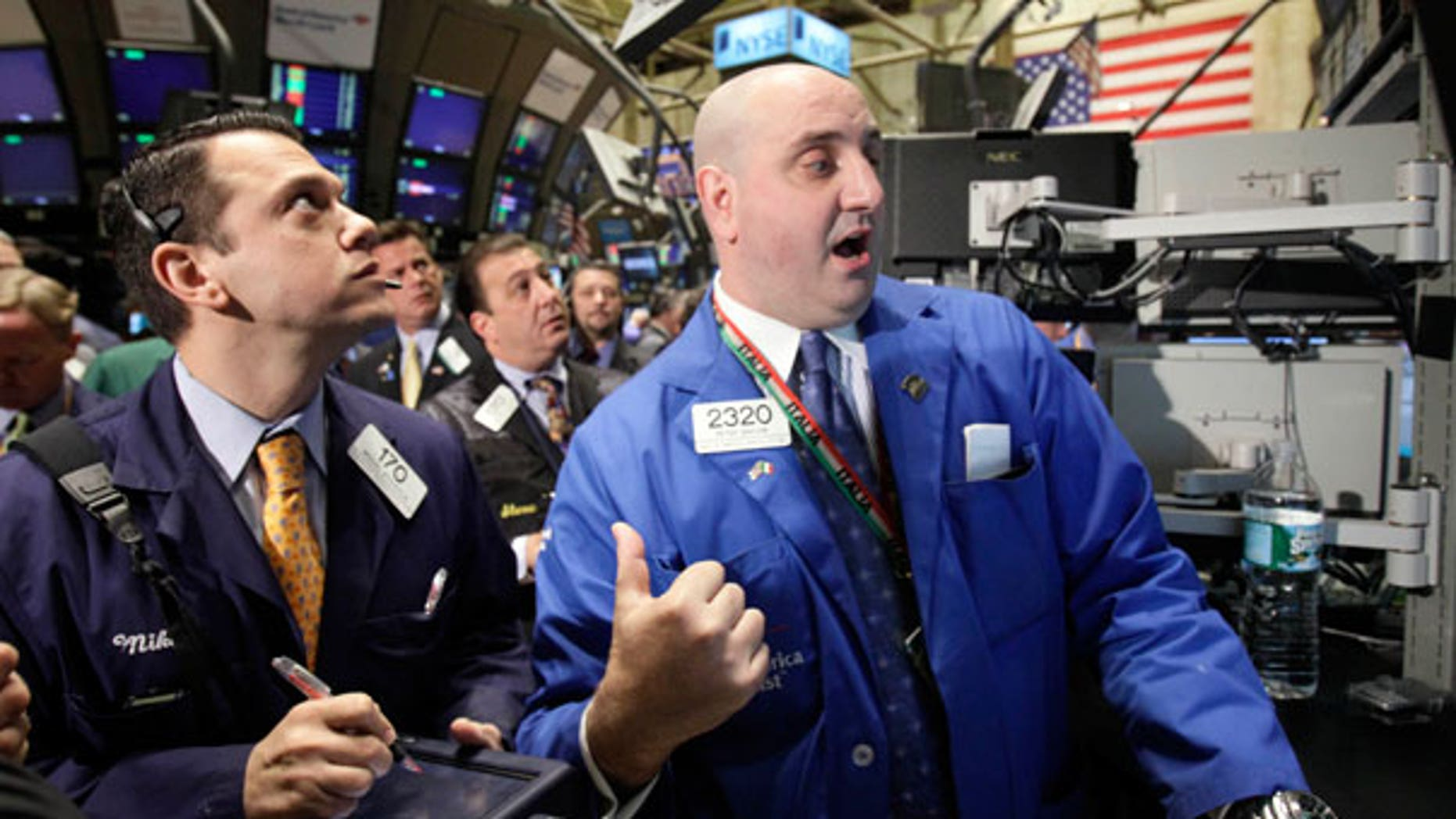 April 19: A specialist directs trades in shares of Goldman Sachs on the floor of the New York Stock Exchange.