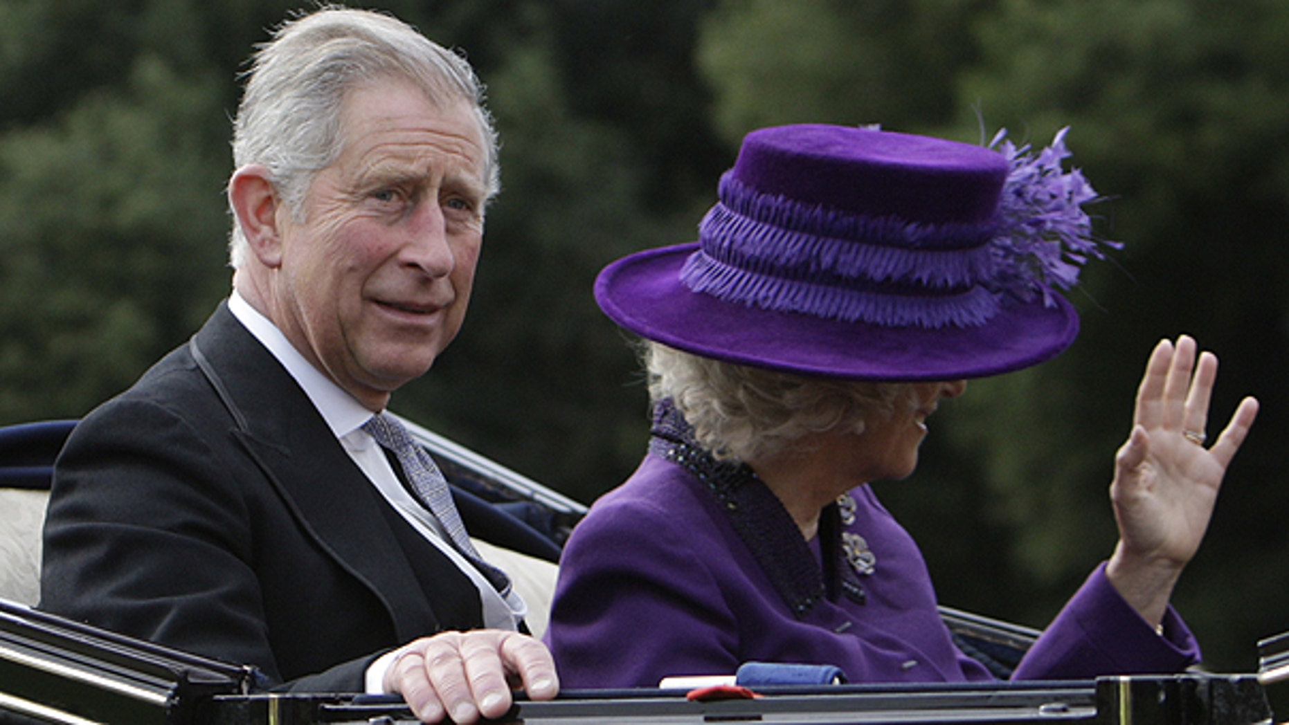 In this Oct. 27, 2009 file photo, Britain's Prince Charles, left, and his wife Camilla, Duchess of Cornwall are seen in a carriage during a state procession with Britain's Queen Elizabeth II and visiting Indian President Pratibha Patil at Windsor Castle, England.