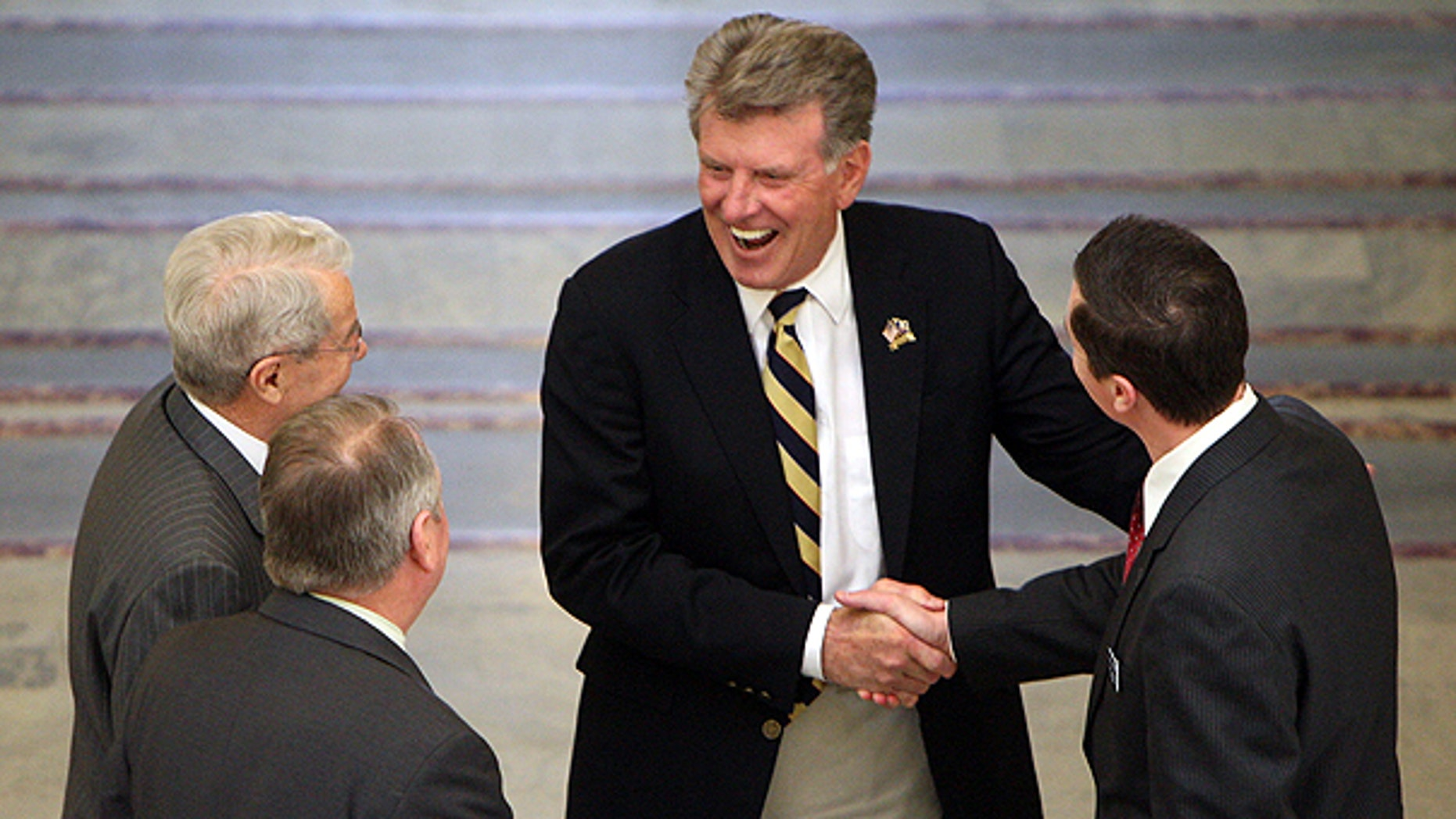April 7: A House committee made up of Reps. Brian Cronin, far right, Fred Wood, and Dell Raybould, far left, inform Idaho Gov. Butch Otter , center, of the body's intent to adjourn for the 2011 legislative session in Boise.
