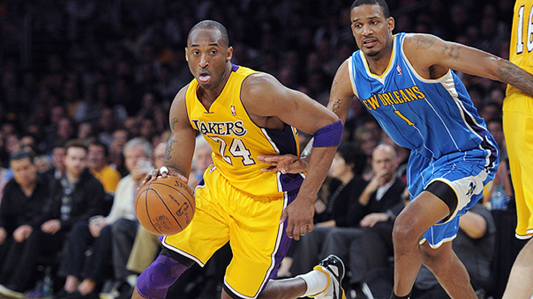 April 20: Los Angeles Lakers guard Kobe Bryant, left, drives toward the basket as New Orleans Hornets forward Trevor Ariza defends during the first half of Game 2 of a first-round NBA basketball playoff series in Los Angeles.
