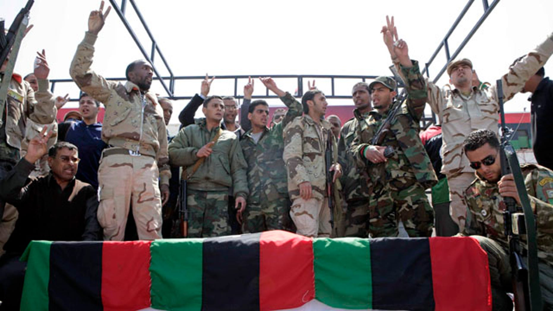 April 19: Libyan rebels surround the coffin of a comrade, whom they say was killed by forces loyal to Mouammar al-Qaddafi in Brega, during a funeral in Benghazi.