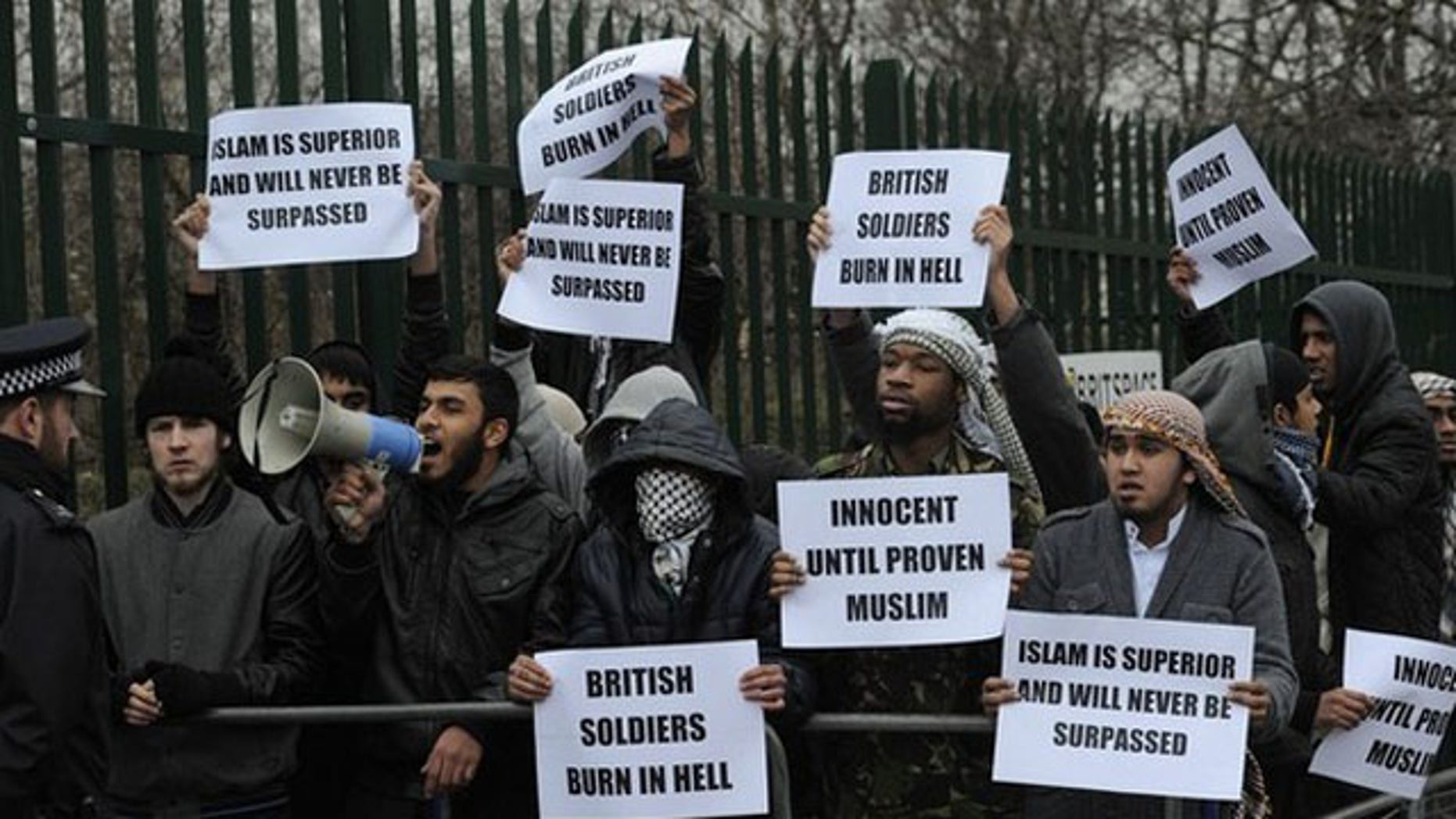 Feb. 23: Demonstrators supporting Mohammad Haque and Emdadur Choudhury protest as they arrive at Belmarsh Magistrates Court in south-east London. The trial of two men accused of burning poppies on the anniversary of Armistice Day started on Wednesday. Mohammad Haque, 30, and Emdadur Choudhury, 26, were arrested during a demonstration by Islamist group Muslims Against Crusades in Kensington, west London, on November 11.