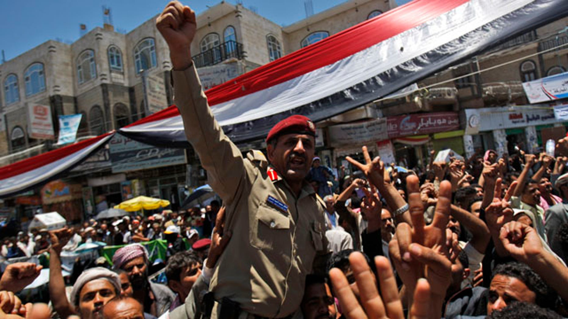 April 20: A Yemeni army officer lifted by anti-government protestors reacts during a demonstration demanding the resignation of Yemeni President Ali Abdullah Saleh in Sanaa, Yemen.