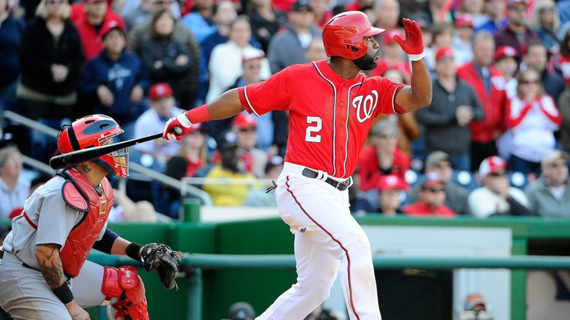 Apr 20, 2014; Washington, DC, USA; Washington Nationals center fielder Denard Span (2) hits a walk off RBI sacrifice fly against the St. Louis Cardinals during the ninth inning at Nationals Park. The Nationals won 3-2. Mandatory Credit: Brad Mills-USA TODAY Sports