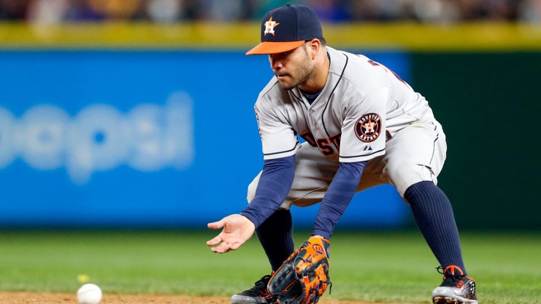 Apr 20, 2015; Seattle, WA, USA; Houston Astros second baseman Jose Altuve (27) fields a grounder against the Seattle Mariners during the eighth inning at Safeco Field. Houston defeated Seattle, 7-5. Mandatory Credit: Joe Nicholson-USA TODAY Sports