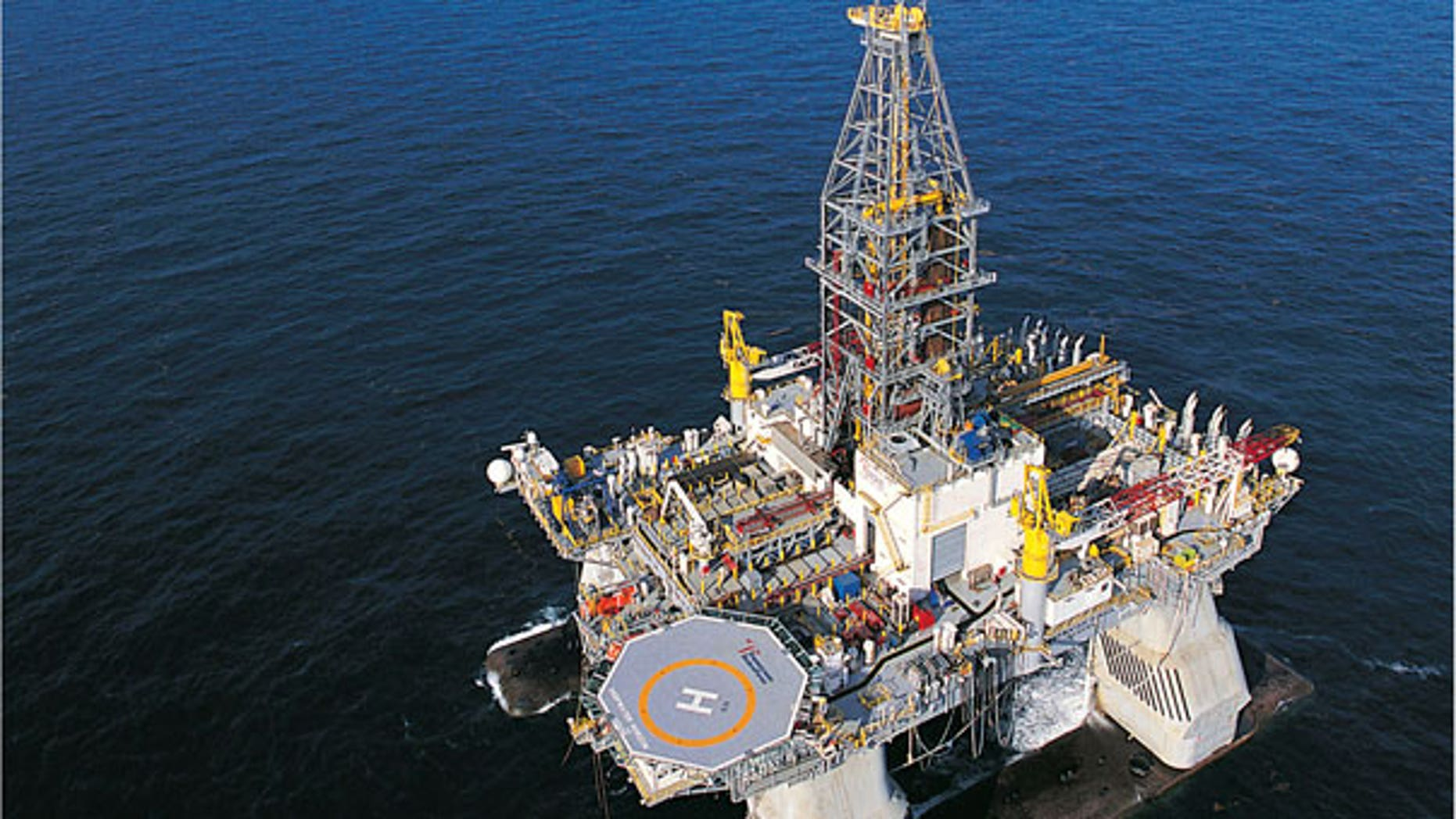 FILE: The Deepwater Horizon rig is shown operating in the U.S. Gulf of Mexico. Authorities were searching for missing workers after an explosion at the oil drilling platform off the coast of Louisiana.