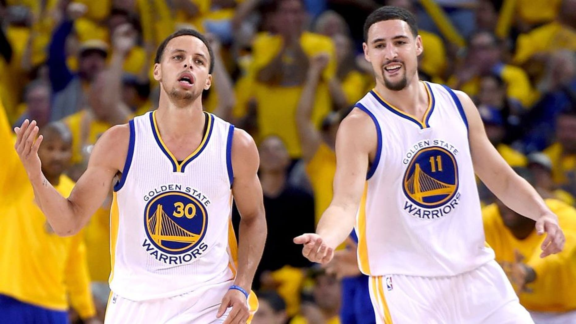 OAKLAND, CA - APRIL 20: Stephen Curry #30, and Klay Thompson #11 of the Golden State Warriors reacts after Curry hit a jump shot against the New Orleans Pelicans in the fourth quarter during the first round of the 2015 NBA Playoffs at ORACLE Arena on April 20, 2015 in Oakland, California. NOTE TO USER: User expressly acknowledges and agrees that, by downloading and or using this photograph, User is consenting to the terms and conditions of the Getty Images License Agreement. (Photo by Thearon W. Henderson/Getty Images)