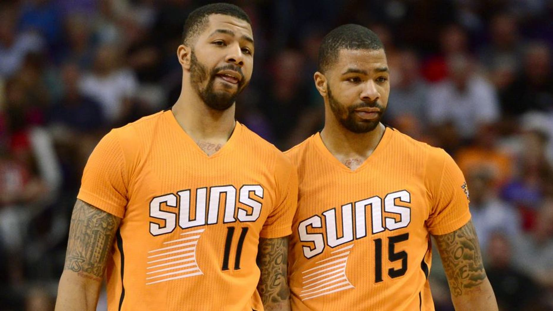 Mar 27, 2015; Phoenix, AZ, USA; Phoenix Suns forward Markieff Morris (11) and Phoenix Suns forward Marcus Morris (15) talk during a timeout against the Portland Trail Blazers at US Airways Center. The Trail Blazers won the game 87-81. Mandatory Credit: Joe Camporeale-USA TODAY Sports