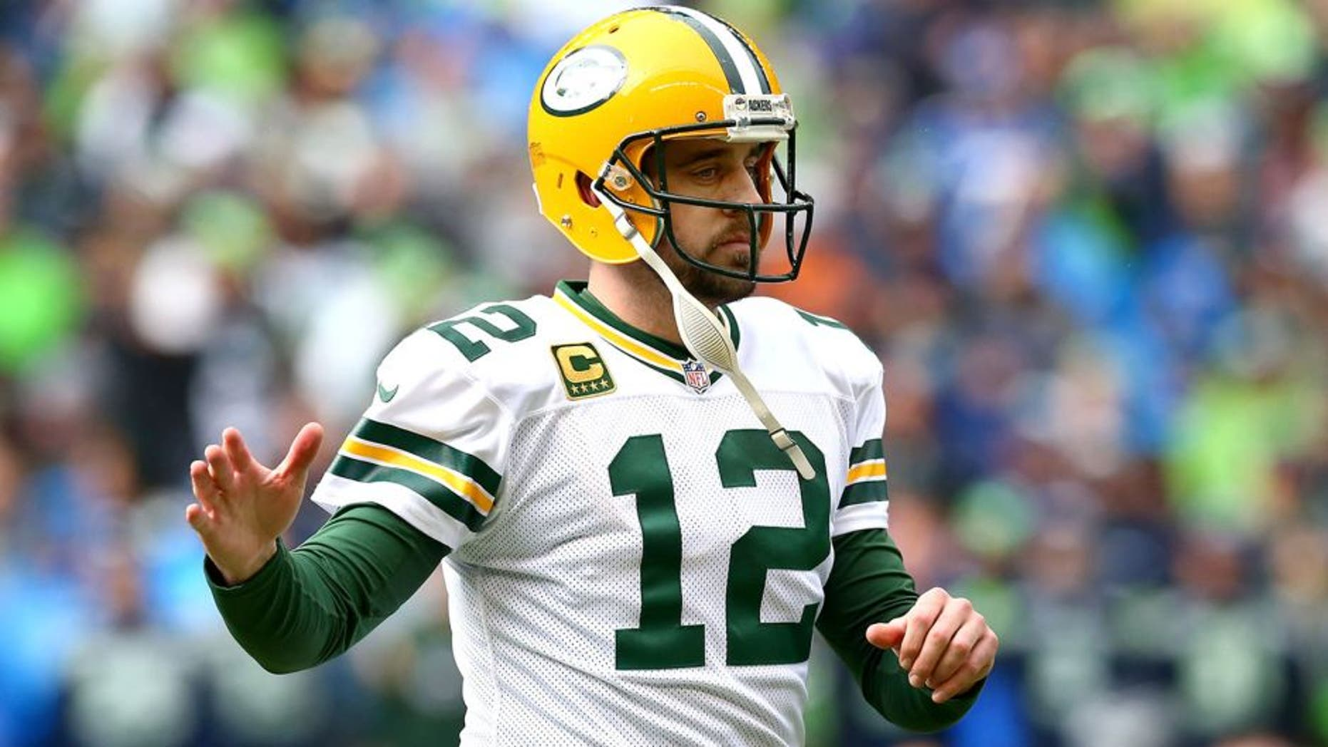 SEATTLE, WA - JANUARY 18: Aaron Rodgers #12 of the Green Bay Packers in action against the Seattle Seahawks during the 2015 NFC Championship game at CenturyLink Field on January 18, 2015 in Seattle, Washington. (Photo by Ronald Martinez/Getty Images)