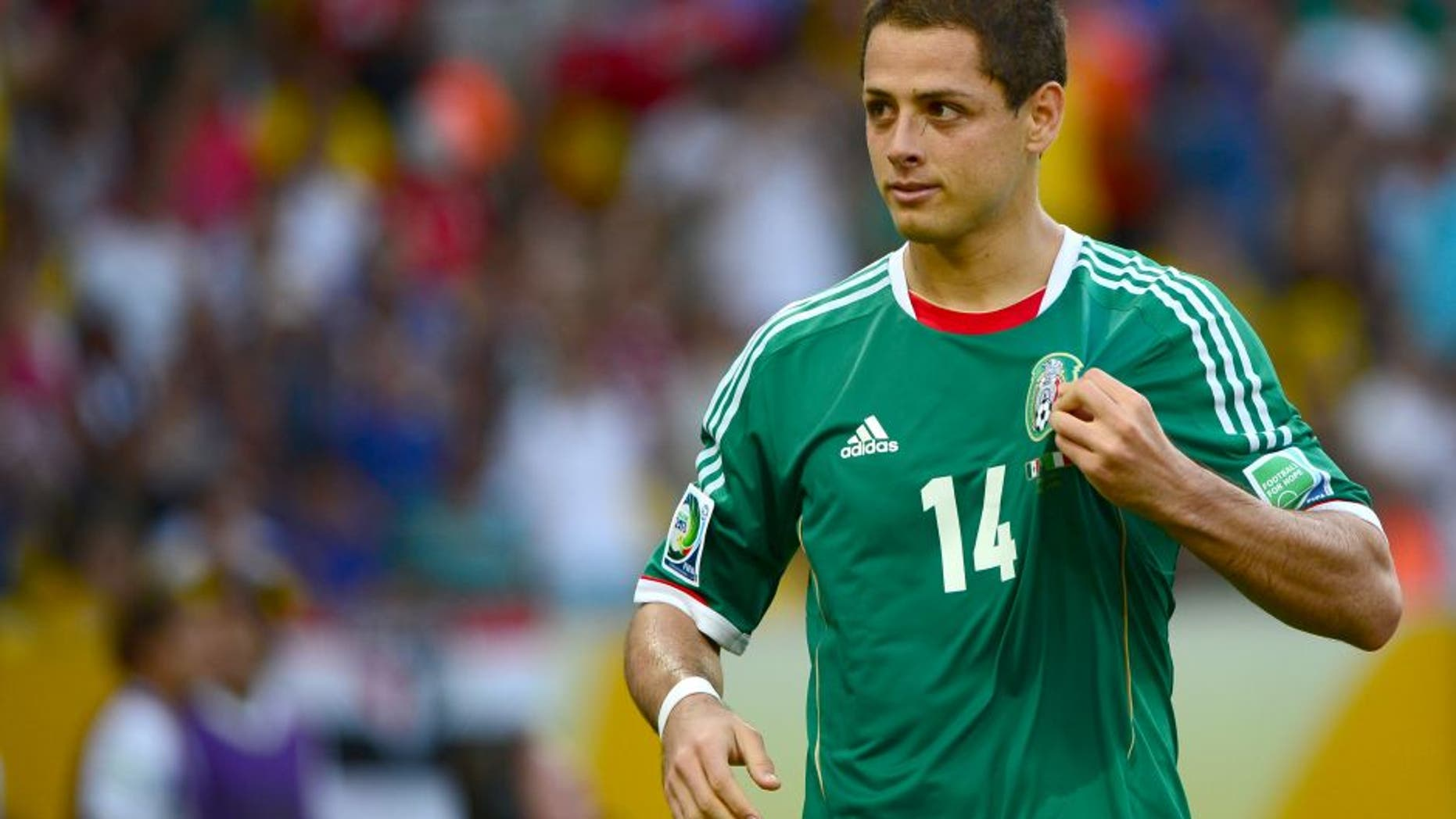 Mexico's forward Javier Hernandez celebrates after scoring a penalty against Italy, during their FIFA Confederations Cup Brazil 2013 Group A football match, at the Maracana Stadium in Rio de Janeiro on June 16, 2013. AFP PHOTO / CHRISTOPHE SIMON (Photo credit should read CHRISTOPHE SIMON/AFP/Getty Images)