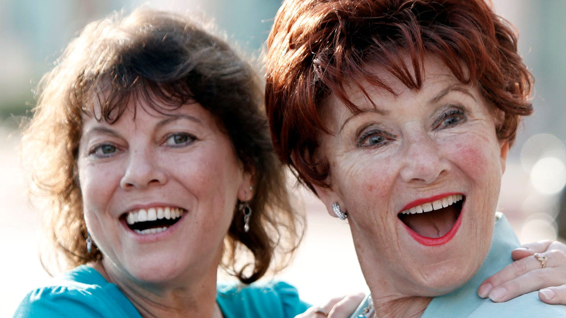 """FILE - In this June 18, 2009 file photo, actresses Erin Moran, left, and Marion Ross pose together at the Academy of Television Arts and Sciences' """"A Father's Day Salute to TV Dads"""" in the North Hollywood section of Los Angeles."""