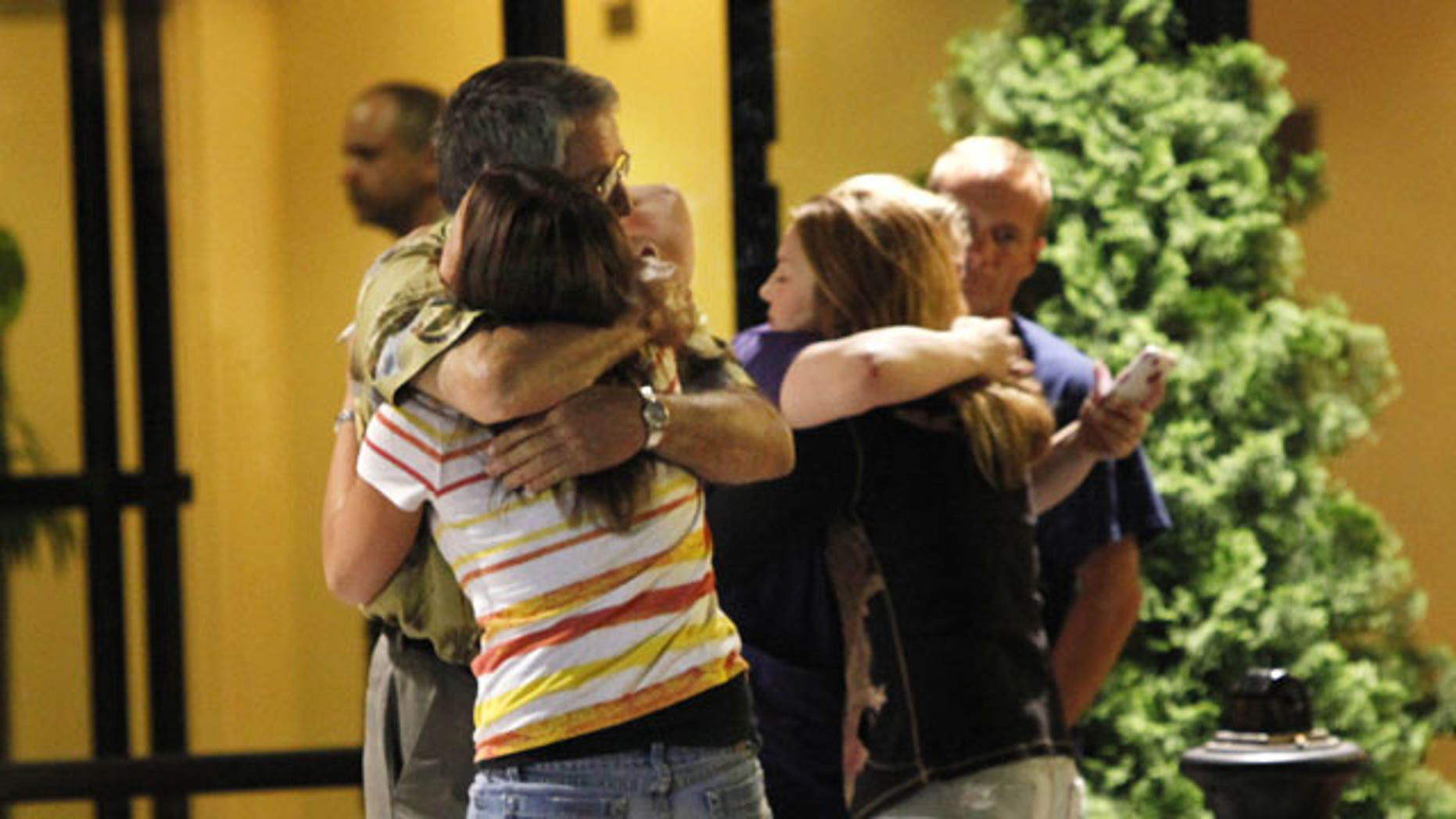 Stanley Murray, left, father of Chad Murray, who was rescued from the Deepwater Horizon oil rig that exploded in the Gulf of Mexico, and Christy Murray, background right, hug loved ones of their unidentified neighbor, a crew member reported missing, after surviving crew members arrived at a hotel in Kenner, La., Thursday, April 22, 2010.