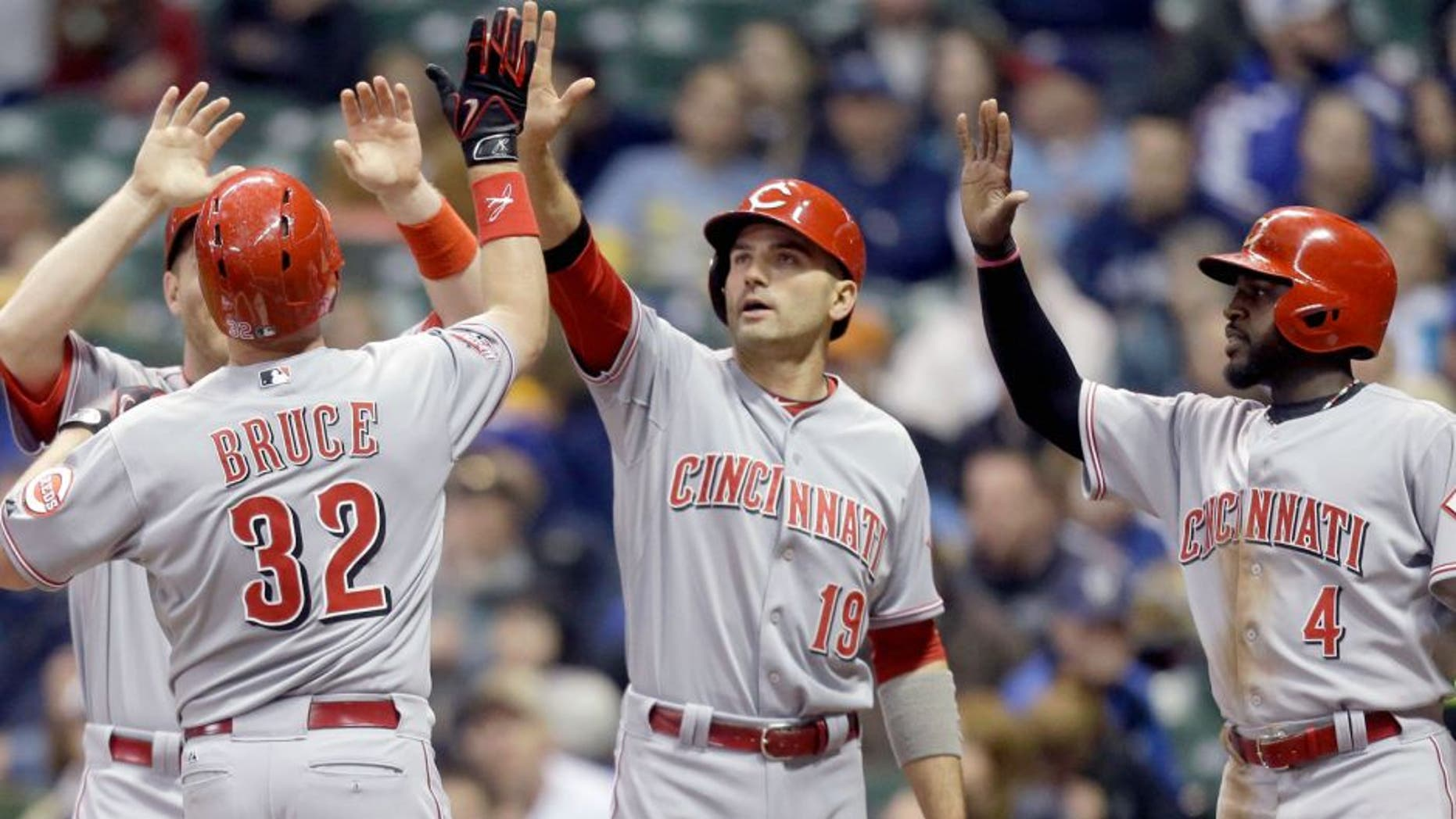 MILWAUKEE, WI - APRIL 21: Jay Bruce #32 of the Cincinnati Reds celebrates with Todd Frazier #21, Joey Votto #19 and Brandon Phillips #4 after hitting a grand slam in the third inning against the Milwaukee Brewers at Miller Park on April 21, 2015 in Milwaukee, Wisconsin. (Photo by Mike McGinnis/Getty Images)
