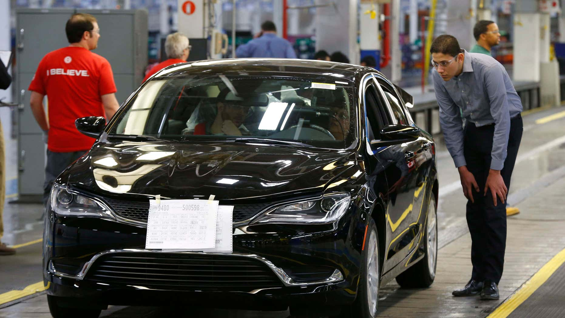 FILE - In this March 14, 2014 file photo, a 2015 Chrysler 200 automobile rolls down the assembly line at the Sterling Heights Assembly Plant in Sterling Heights, Mich.