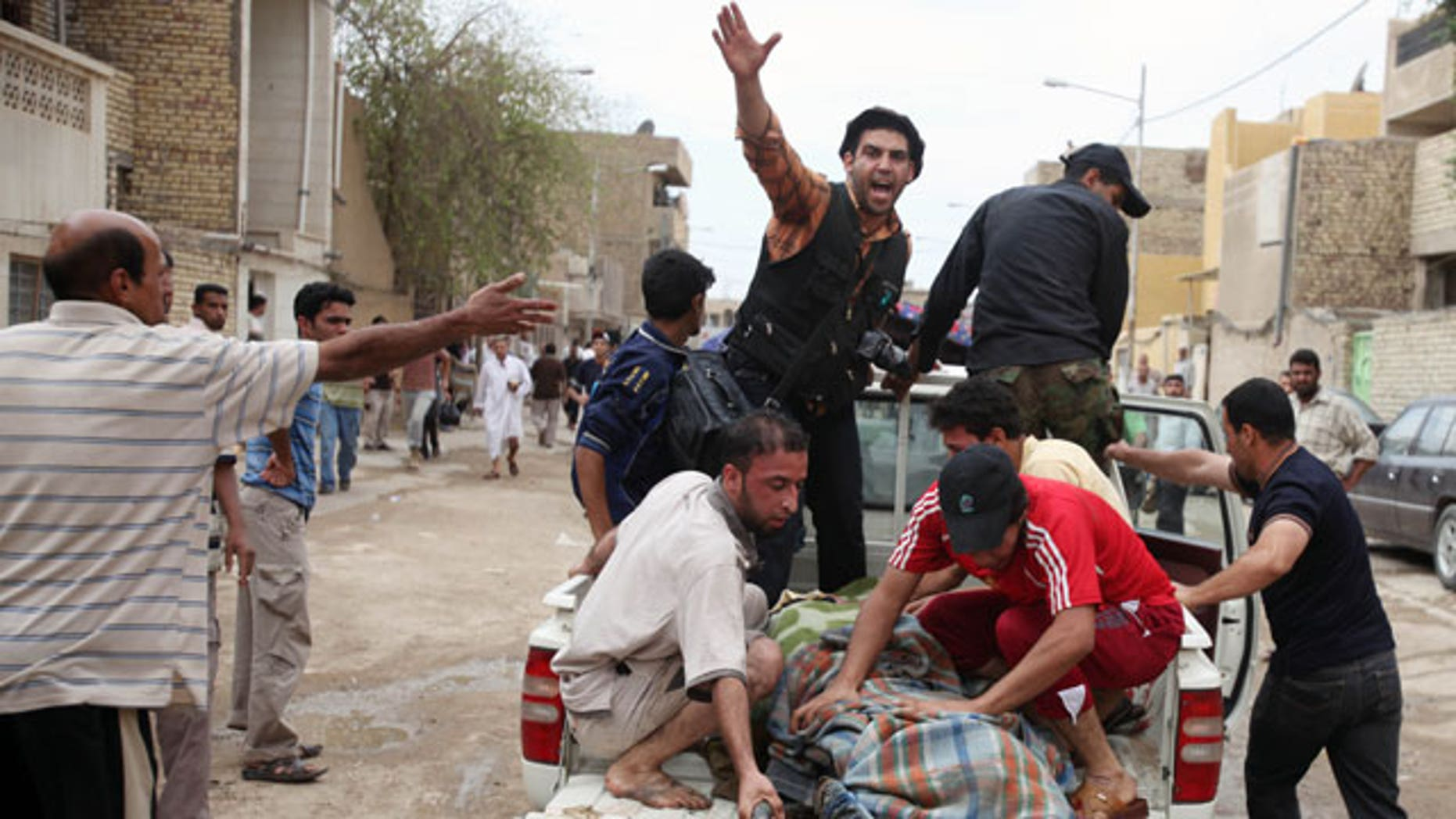A victim is evacuated after a series of bombs exploded in the Shiite stronghold of Sadr City in Baghdad, Iraq, Friday, April 23, 2010. Iraqi officials say several people were killed when a series of bombs targeted the Sadrist offices. The bombings appeared to be targeting worshippers on their way to and from Friday afternoon prayers.