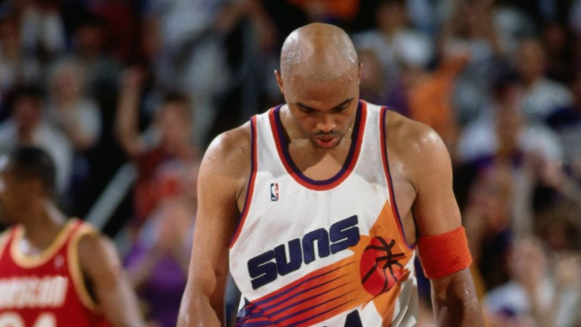 PHOENIX - MAY 20: Charles Barkley #34 of the Phoenix Suns walks with his head down during Game Seven of the 1995 NBA Western Conference semifinals against the Houston Rockets on May 20, 1995 at the American West Arena in Phoenix, Arizona. Houston defeated Phoenix 115-114 and won the series 4-3. NOTE TO USER: User expressly acknowledges that, by downloading and or using this photograph, User is consenting to the terms and conditions of the Getty Images License agreement. Mandatory Copyright Notice: Copyright 1995 NBAE (Photo by Andrew D. Bernstein/NBAE via Getty Images)
