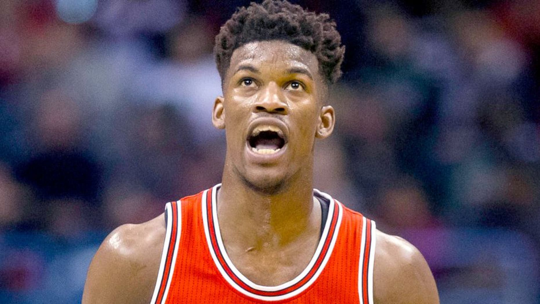 Apr 23, 2015; Milwaukee, WI, USA; Chicago Bulls guard Jimmy Butler (21) reacts after making a basket during the third quarter against the Milwaukee Bucks in game three of the first round of the NBA Playoffs at BMO Harris Bradley Center. Mandatory Credit: Jeff Hanisch-USA TODAY Sports