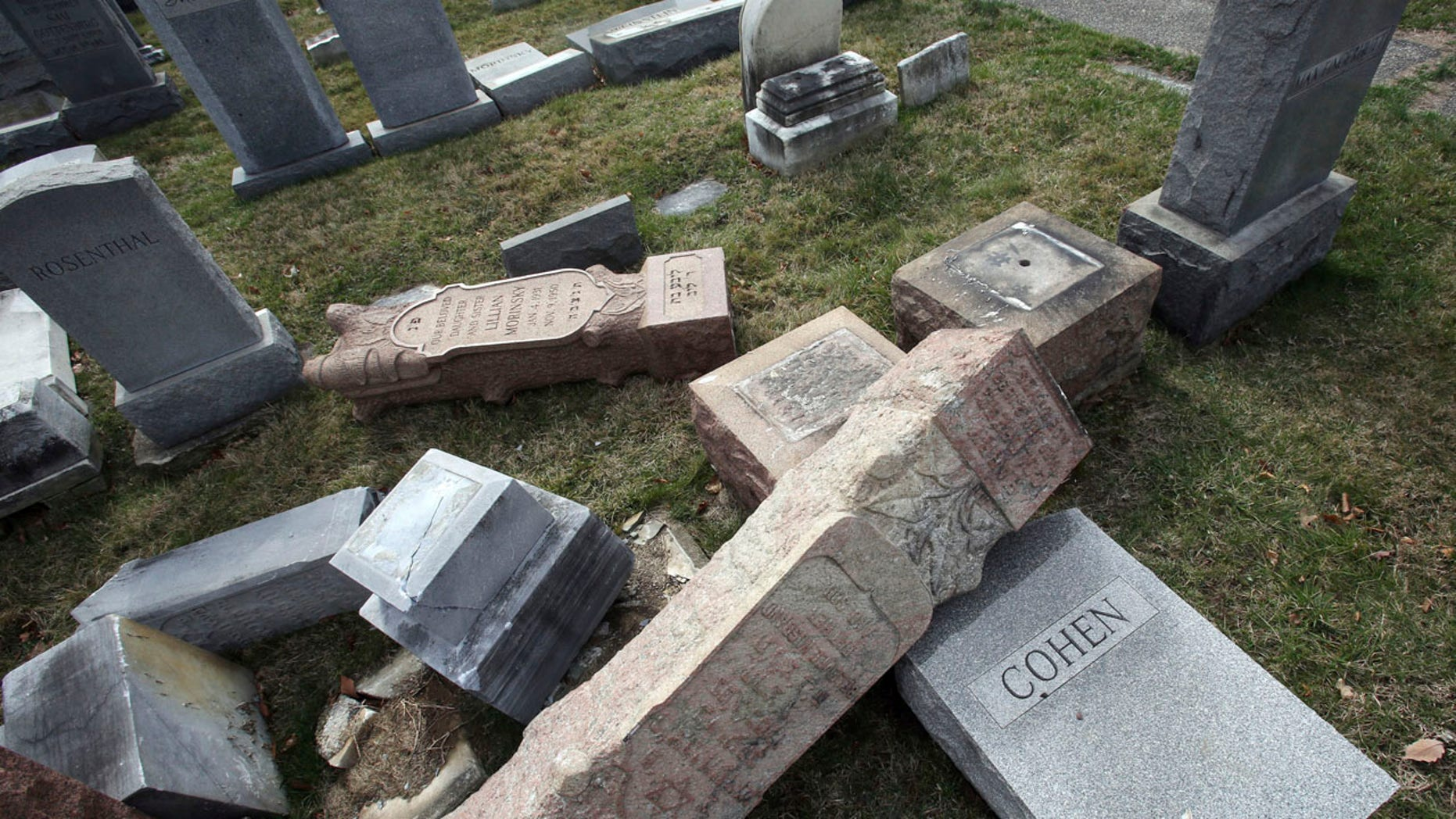 Monday, Feb. 27, 2017: Toppled and damaged headstones rest on the ground at Mount Carmel Cemetery in Philadelphia. The Anti-Defamation League found an increase in cases of anti-Semitic intimidation and vandalism in 2016, evidence that anti-Jewish bias intensified during the election.