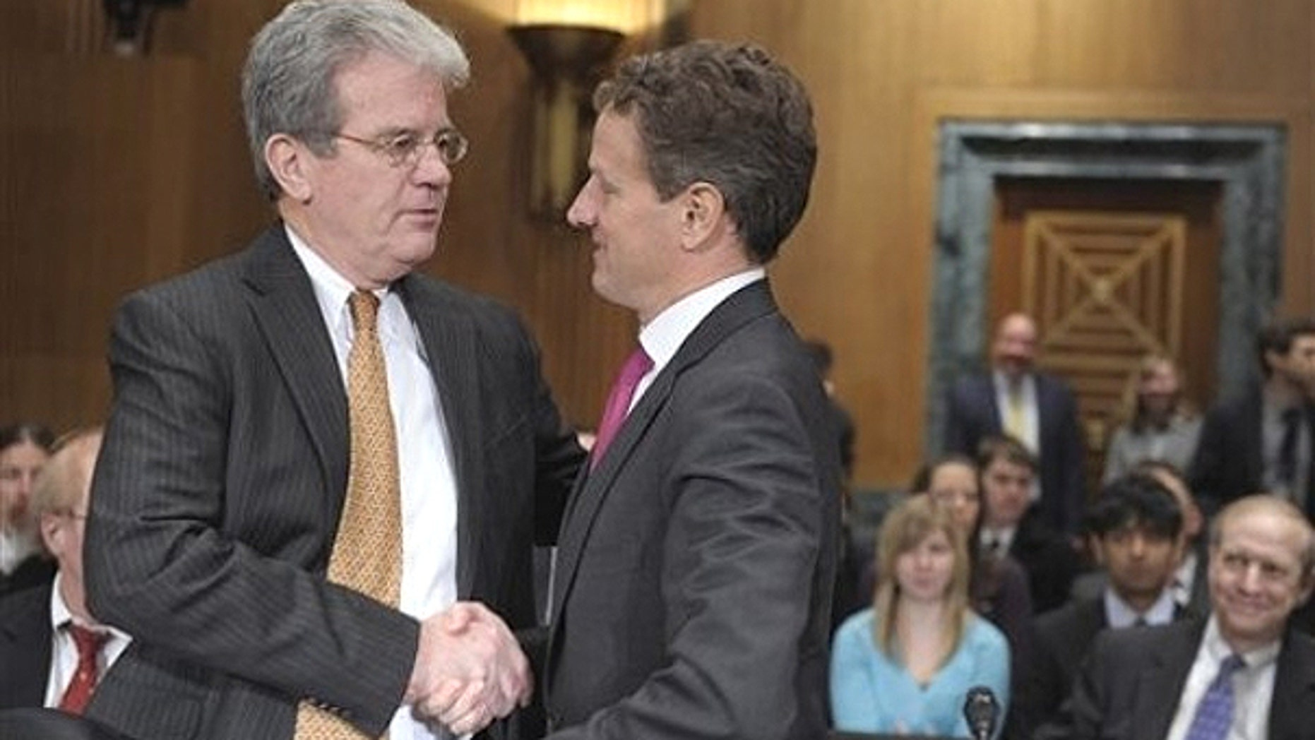 Feb. 16: Senate Finance Committee member Sen. Tom Coburn, R-Okla. , left., talks with Treasury Secretary Timothy Geithner on Capitol Hill in Washington.