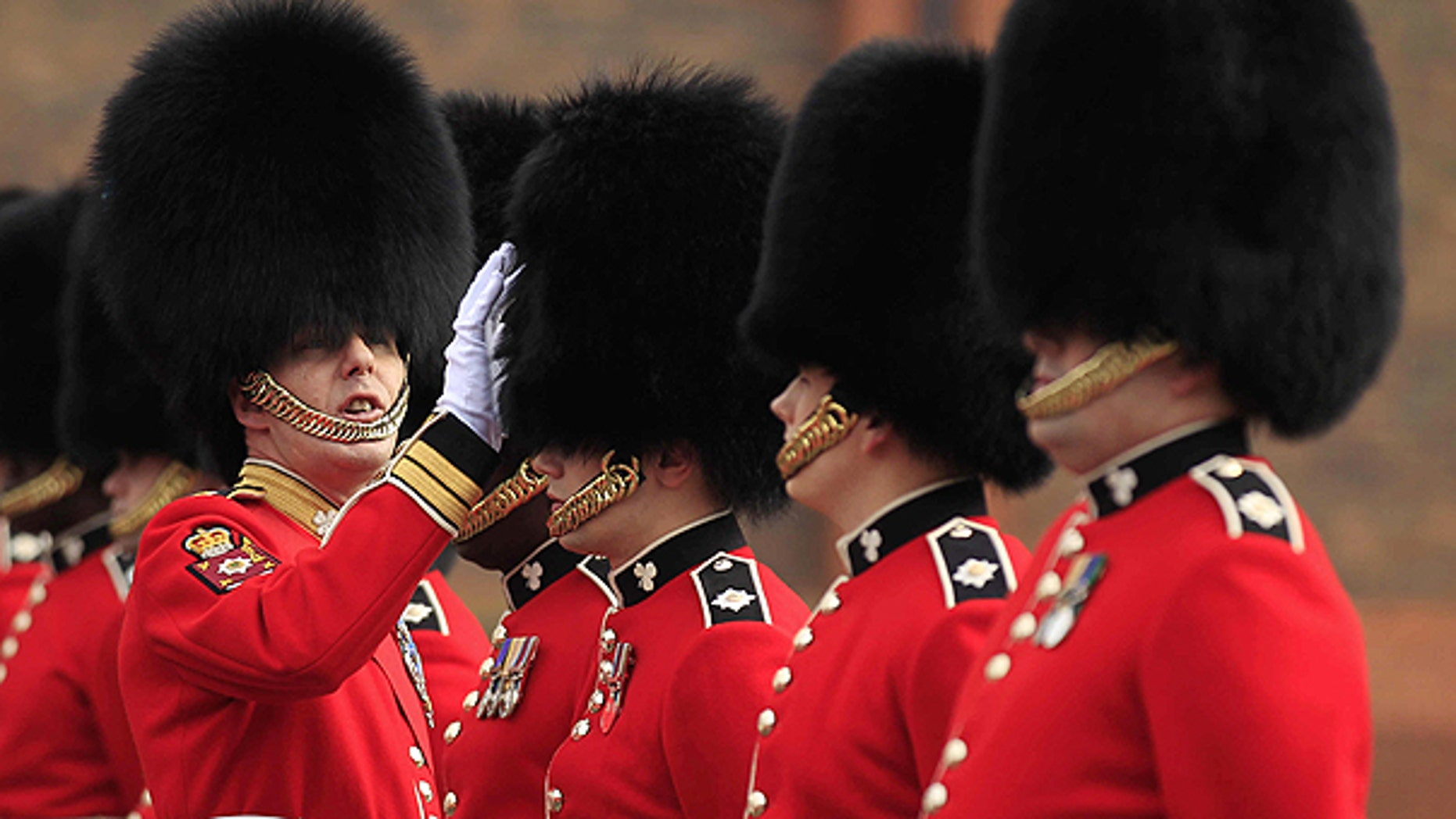 April 21: A Company Sergeant Major of the 1st Battalion Irish Guards inspects guardsmen's bearskins, as they take part in an inspection ahead of the royal wedding at their barracks in Windsor, England.