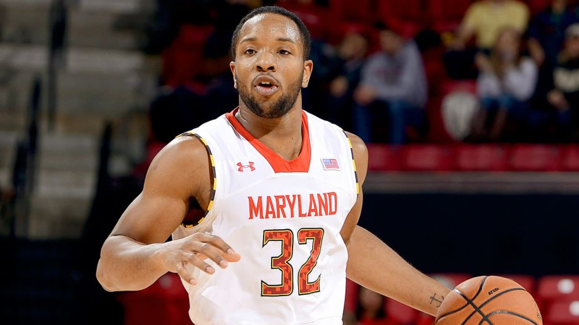 COLLEGE PARK, MD - FEBRUARY 18: Dez Wells #32 of the Maryland Terrapins handles the ball against the Wake Forest Demon Deacons at the Comcast Center on February 18, 2014 in College Park, Maryland. (Photo by G Fiume/Maryland Terrapins/Getty Images) *** Local Caption *** Dez Wells