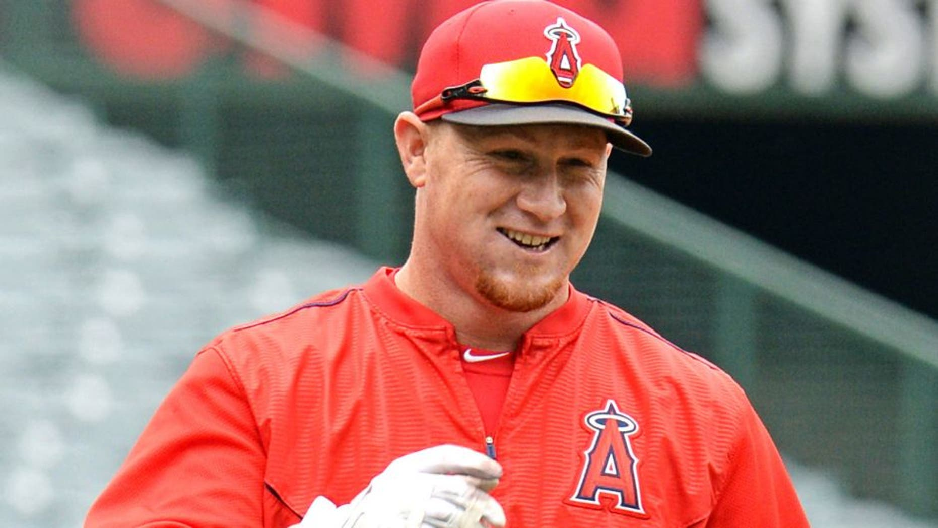 Apr 22, 2015; Anaheim, CA, USA; Los Angeles Angels right fielder Kole Calhoun (56) warms up before the game against the Oakland Athletics at Angel Stadium of Anaheim. Mandatory Credit: Jayne Kamin-Oncea-USA TODAY Sports