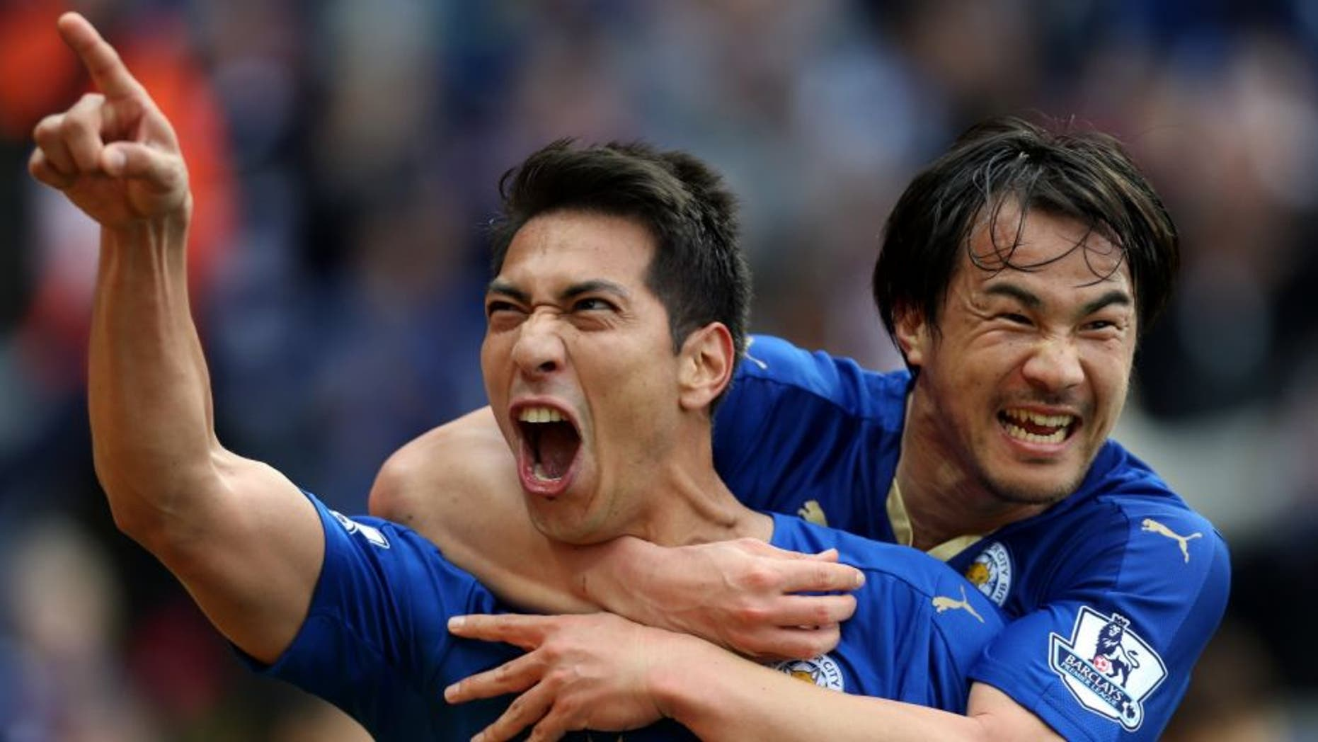 LEICESTER, ENGLAND - APRIL 24 : Leonardo Ulloa of Leicester City celebrates with Shinji Okazaki of Leicester City after scoring to make it 2-0 during the Barclays Premier League match between Leicester City and Swansea City at the King Power Stadium on April 24 , 2016 in Leicester, United Kingdom. (Photo by Plumb Images/Leicester City FC via Getty Images)