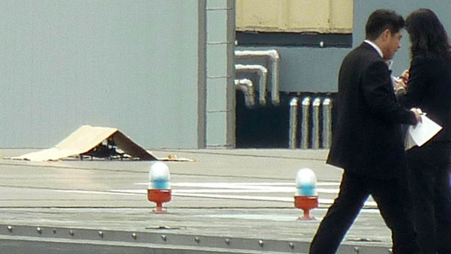 April 22, 2015: A small drone covered with cardboard, is seen on the roof of Prime Minister Shinzo Abe's official residence in Tokyo.