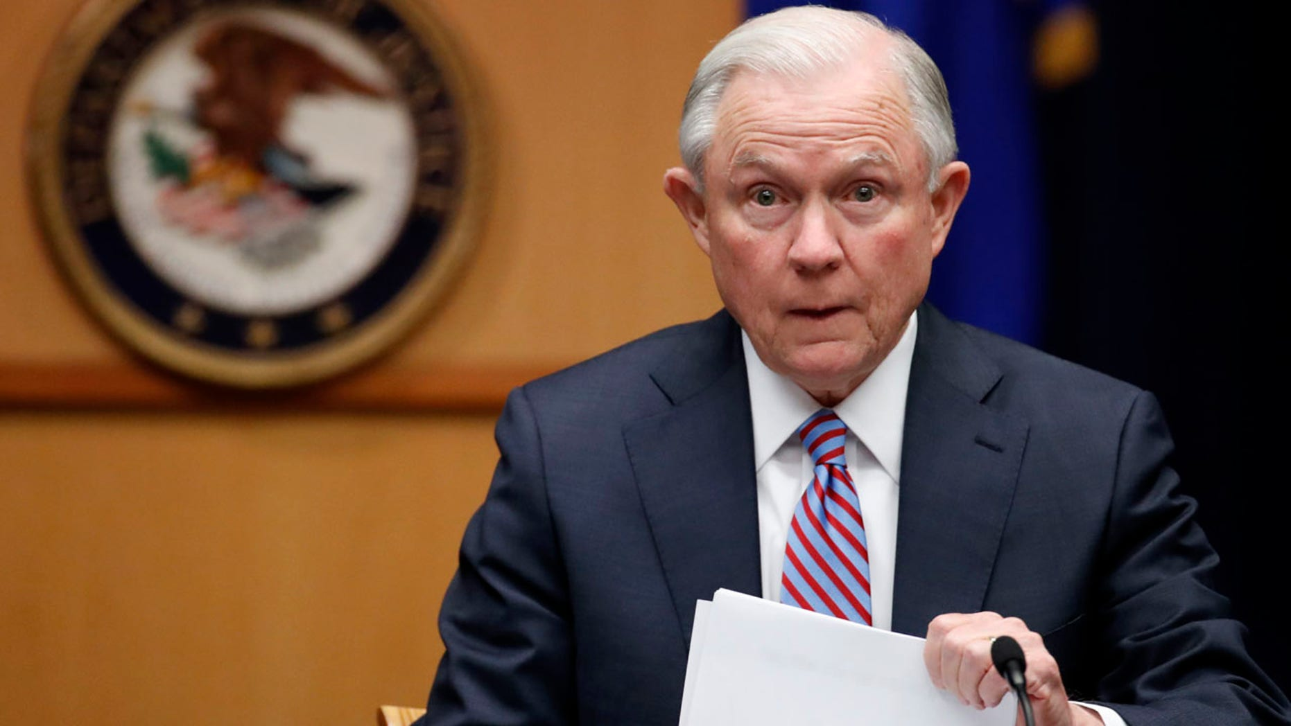 In this April 18, 2017 file photo Attorney General Jeff Sessions prepares to speak before a meeting of the Attorney General's Organized Crime Council and Organized Crime Drug Enforcement Task Forces (OCDETF) Executive Committee to discuss implementation of the President's Executive Order 13773, at the Department of Justice in Washington.