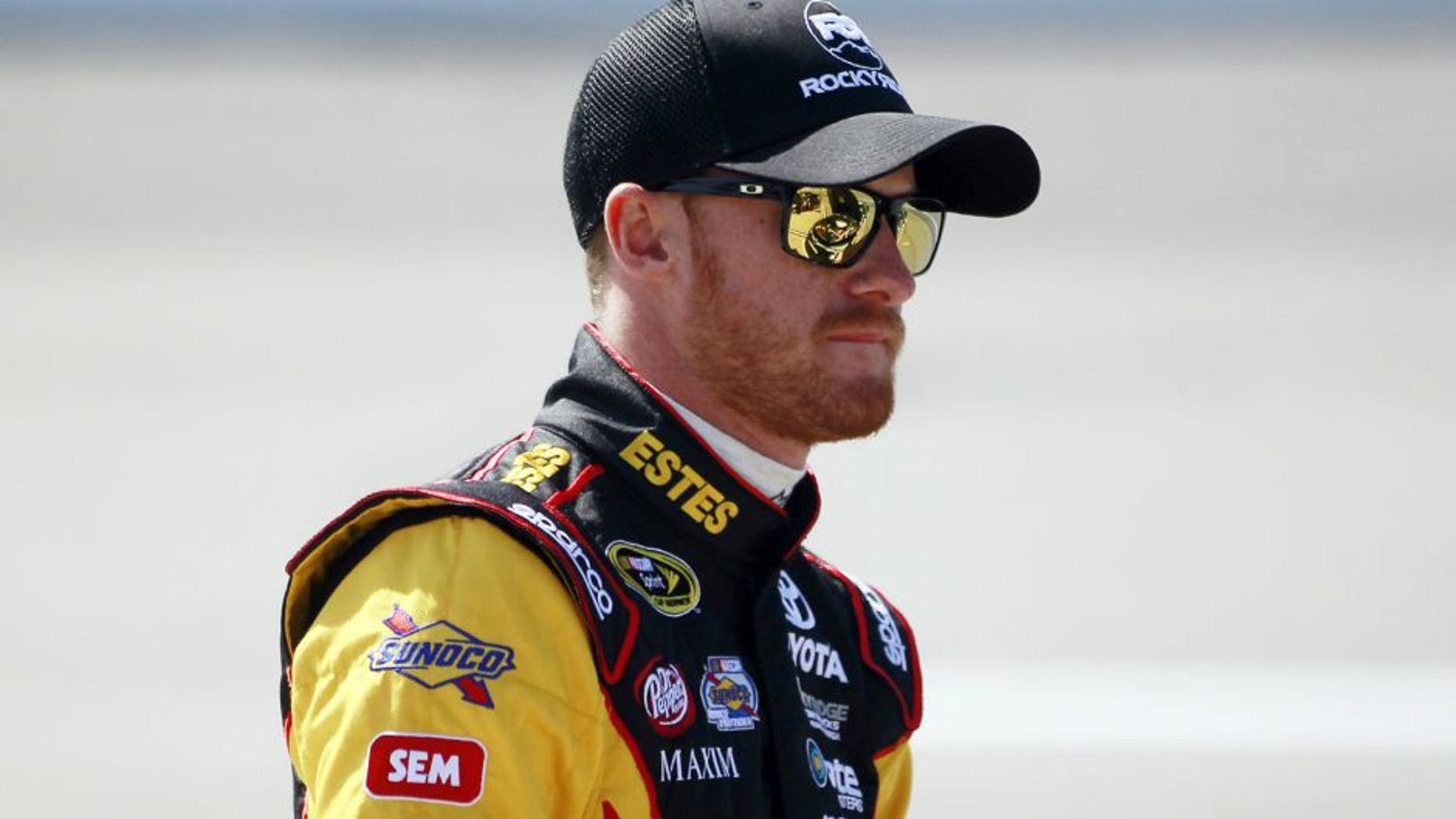 RICHMOND, VA - APRIL 24: Jeb Burton, driver of the #26 Estes Express Lines Toyota, stands on the grid during practice for the NASCAR Sprint Cup Series Toyota Owners 400 at Richmond International Raceway on April 24, 2015 in Richmond, Virginia. (Photo by Brian Lawdermilk/NASCAR via Getty Images)