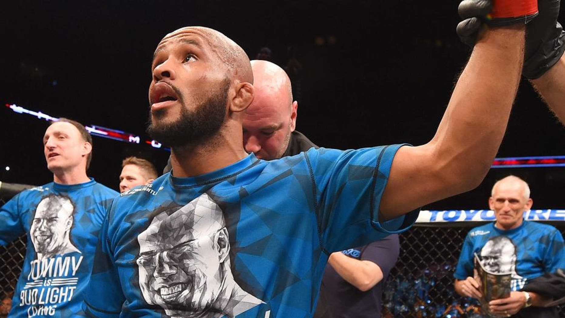 MONTREAL, QC - APRIL 25: Demetrious Johnson of the United States reacts after his submission victory over Kyoji Horiguchi of Japan in their UFC flyweight championship bout during the UFC 186 event at the Bell Centre on April 25, 2015 in Montreal, Quebec, Canada. (Photo by Josh Hedges/Zuffa LLC/Zuffa LLC via Getty Images)