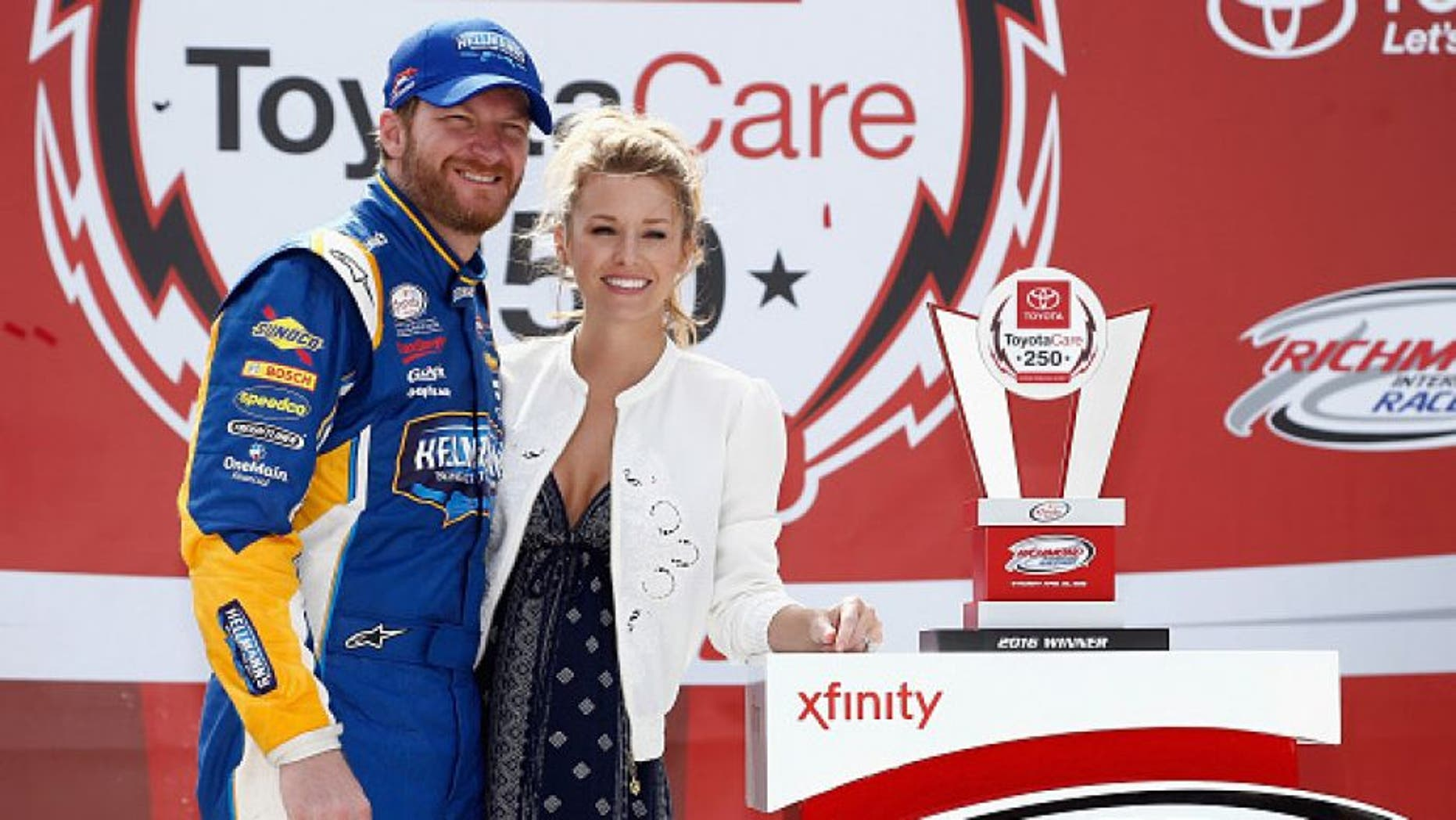 RICHMOND, VA - APRIL 23: Dale Earnhardt Jr., driver of the #88 Hellmann's Chevrolet, poses for a photo with his girlfriend Amy Reimann in Victory Lane after winning the NASCAR XFINITY Series ToyotaCare 250 at Richmond International Raceway on April 23, 2016 in Richmond, Virginia. (Photo by Jeff Zelevansky/Getty Images)