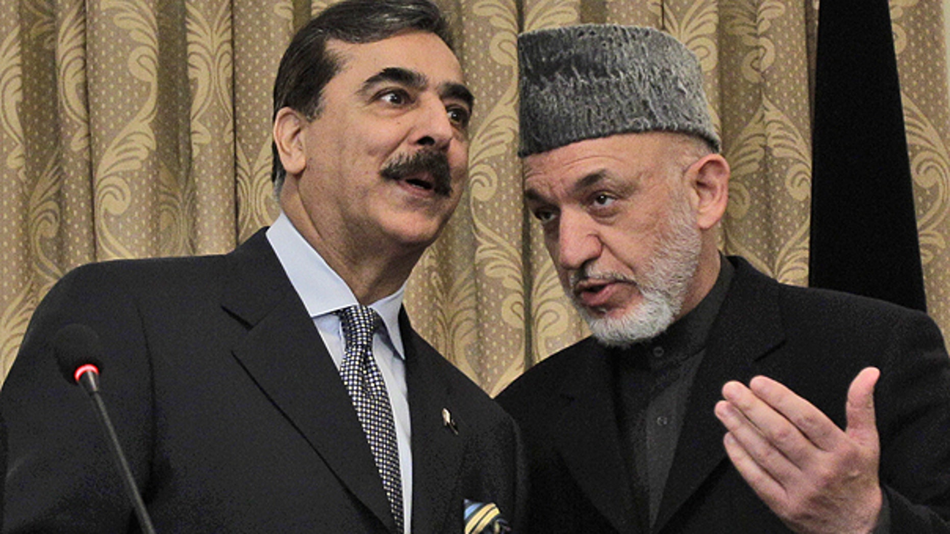 April 16: Pakistan's Prime Minister Raza Gilani, left, speaks with Afghanistan's President Hamid Karzai during a news conference in Kabul, Afghanistan.