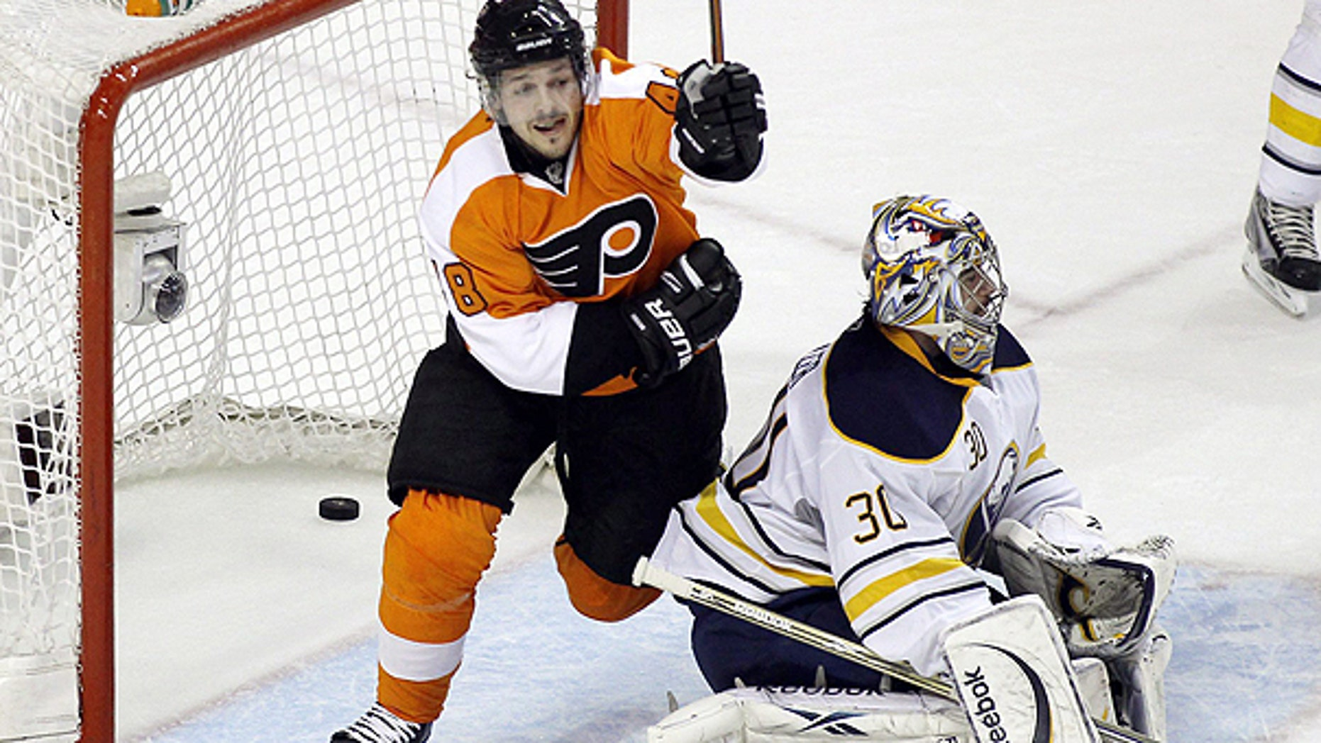 April 26: Philadelphia Flyers' Danny Briere reacts after Braydon Coburn's slap shot gets past Buffalo Sabres' goalie Ryan Miller in the first period in Game 7 of a first-round NHL Stanley Cup playoffs hockey series in Philadelphia.