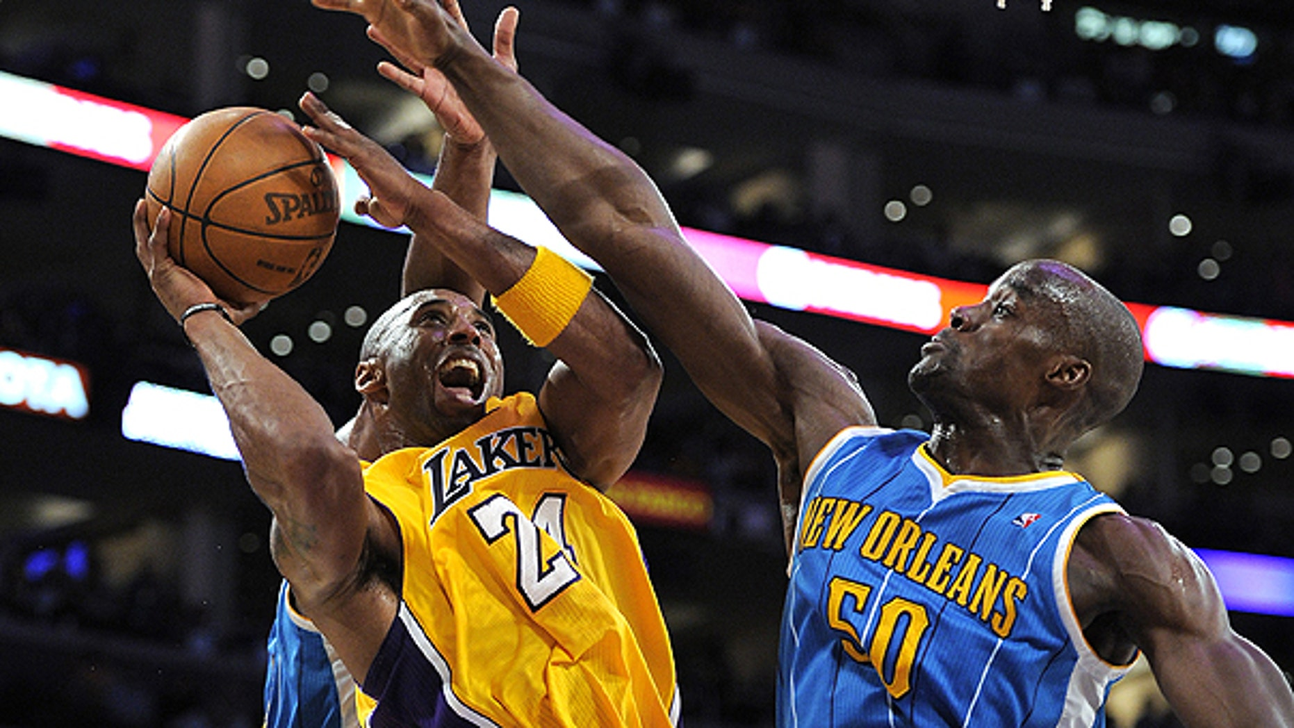 April 26: Los Angeles Lakers guard Kobe Bryant, left, goes up for a shot as New Orleans Hornets center Emeka Okafor defends during the second half in Game 5 of a first-round NBA basketball playoff series in Los Angeles.