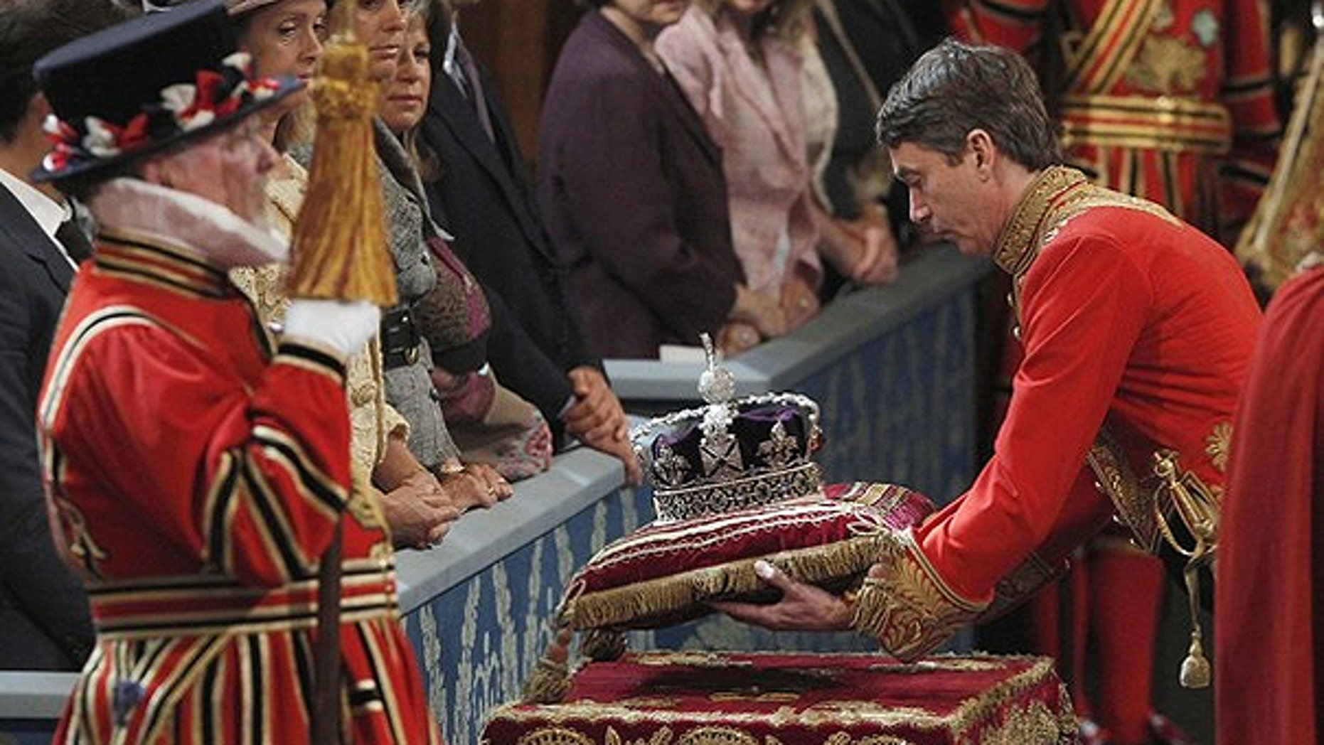 May 25, 2010: The Imperial State Crown is carried into the Royal Gallery for Britain's Queen Elizabeth during the State Opening of Parliament at the Palace of Westminster in London.