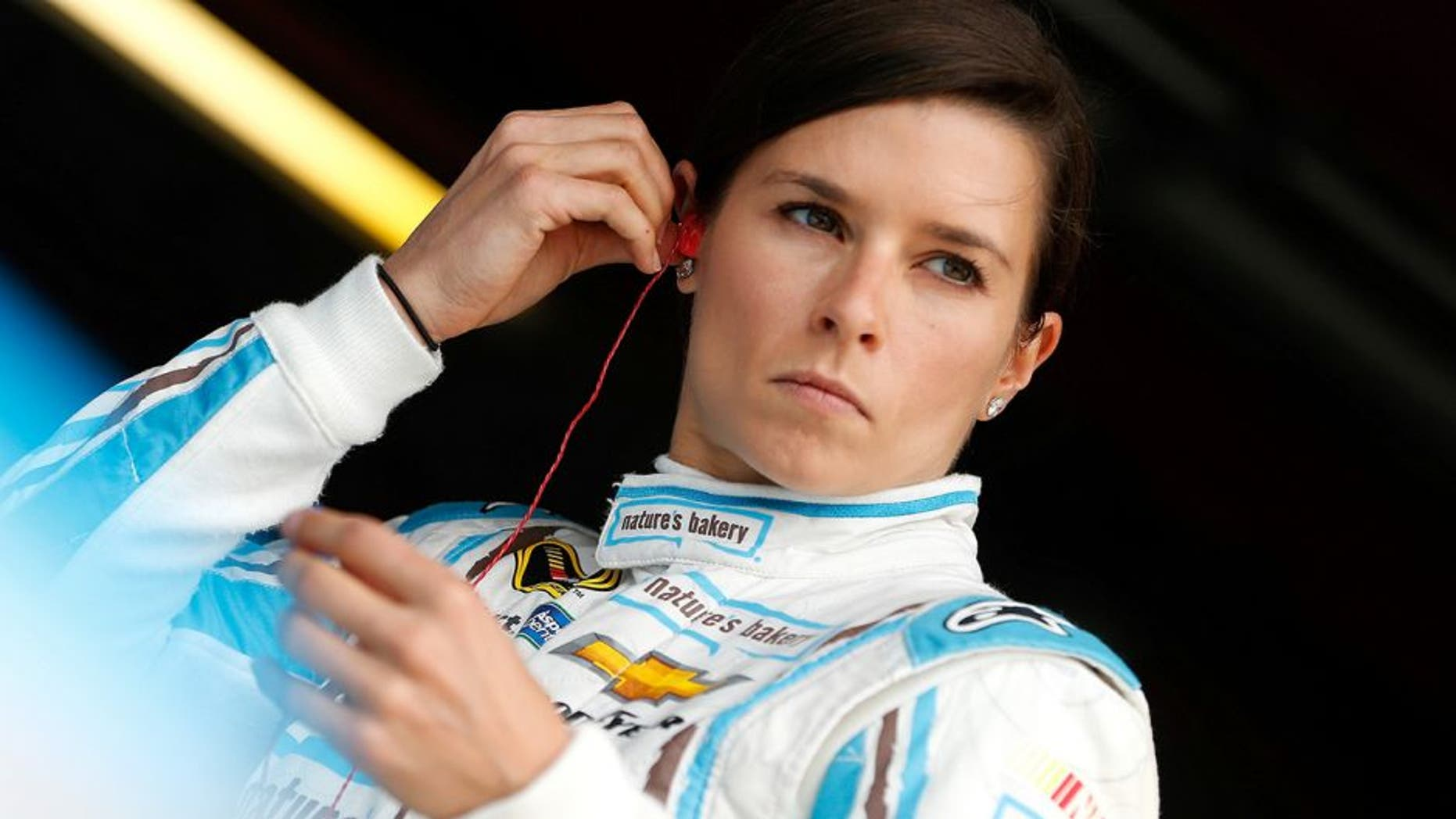 RICHMOND, VA - APRIL 22: Danica Patrick, driver of the #10 Nature's Bakery Chevrolet, stands in the garage area during practice for the NASCAR Sprint Cup Series TOYOTA OWNERS 400 at Richmond International Raceway on April 22, 2016 in Richmond, Virginia. (Photo by Brian Lawdermilk/Getty Images)