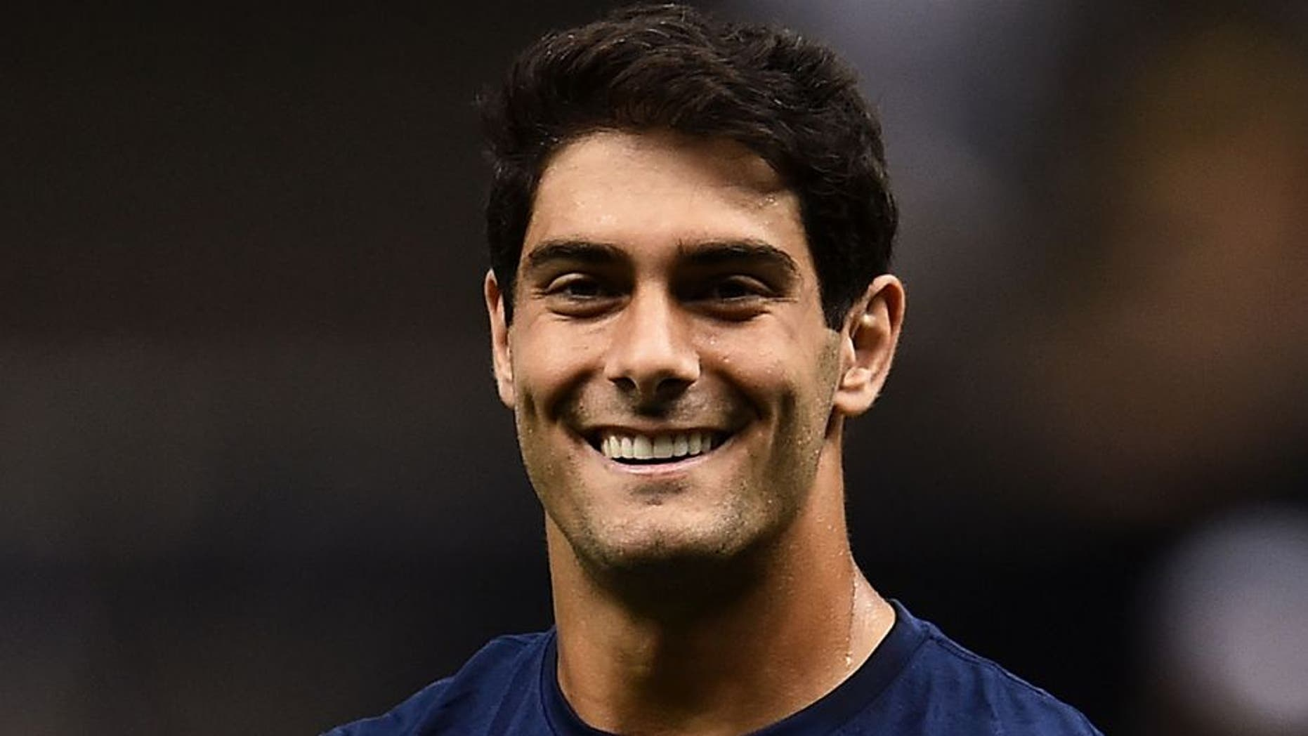 NEW ORLEANS, LA - AUGUST 22: Jimmy Garoppolo #10 of the New England Patriots participates in warmups prior to a preseason game against the New Orleans Saints at the Mercedes-Benz Superdome on August 22, 2015 in New Orleans, Louisiana. (Photo by Stacy Revere/Getty Images)
