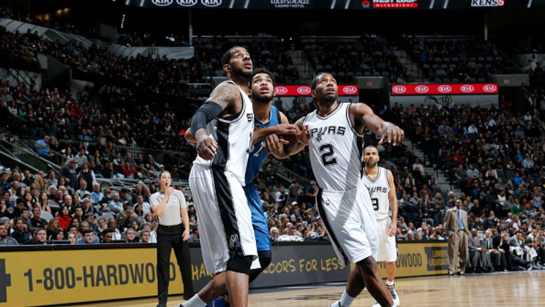 SAN ANTONIO, TX - DECEMBER 28: LaMarcus Aldridge #12 of the San Antonio Spurs and Kawhi Leonard #2 of the San Antonio Spurs box out against Karl-Anthony Towns #32 of the Minnesota Timberwolves on December 28, 2015 at the AT&T Center in San Antonio, Texas. NOTE TO USER: User expressly acknowledges and agrees that, by downloading and or using this photograph, user is consenting to the terms and conditions of the Getty Images License Agreement. Mandatory Copyright Notice: Copyright 2015 NBAE (Photos by Chris Covatta/NBAE via Getty Images)