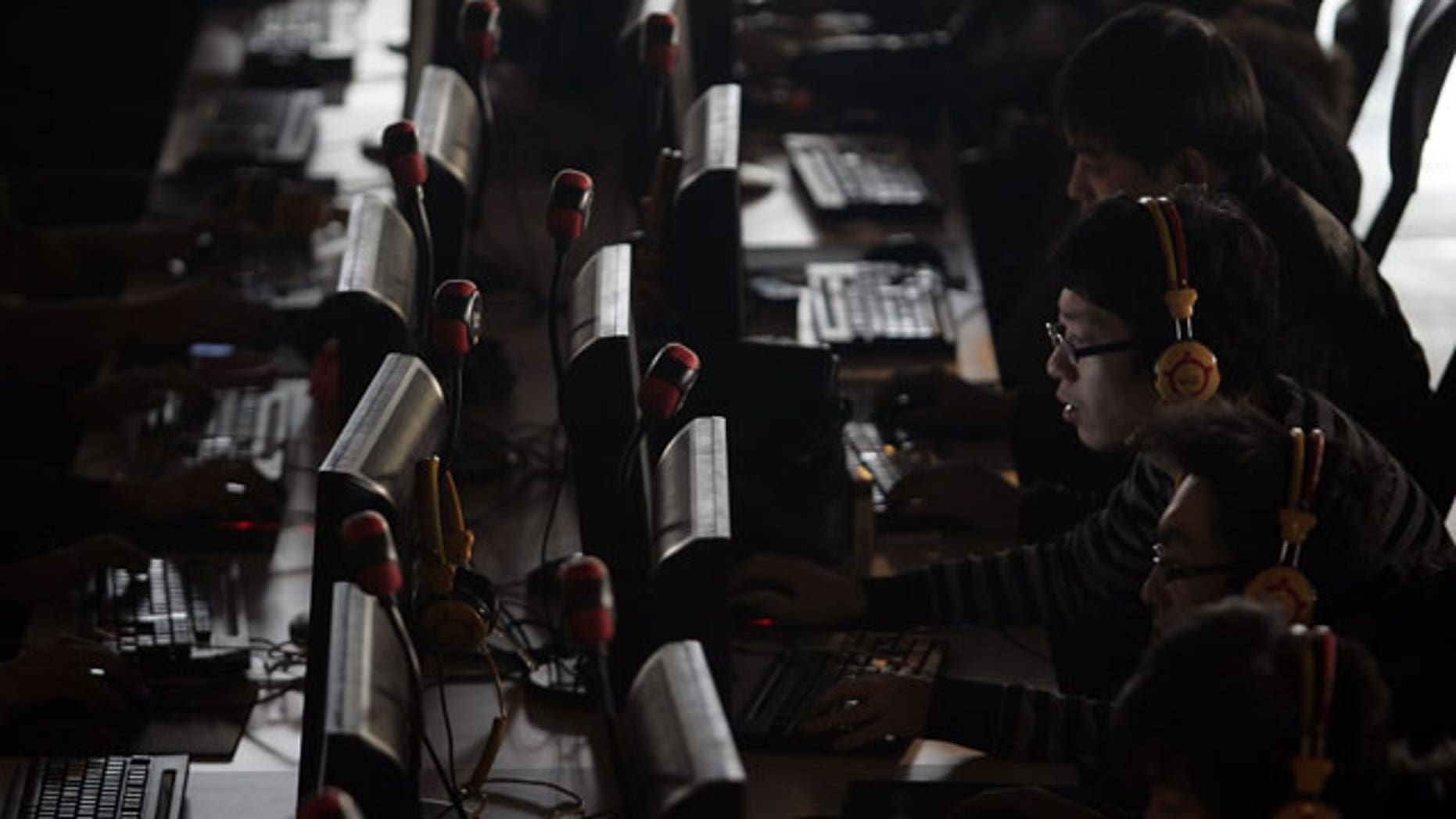 n this Jan. 25, 2010 file photo, people use computers at an Internet cafe in Taiyuan, in north China's Shanxi province. China is poised to pass a law requiring telecommunications and Internet companies to report any revelation of state secrets, potentially forcing businesses to collaborate with the country's vast security apparatus that stifles political dissent. The move to make communications companies monitor and inform on clients' activities, reported Tuesday, April 27, 2010, by state media, comes as China continues tightening controls on the Internet and telecommunications services.
