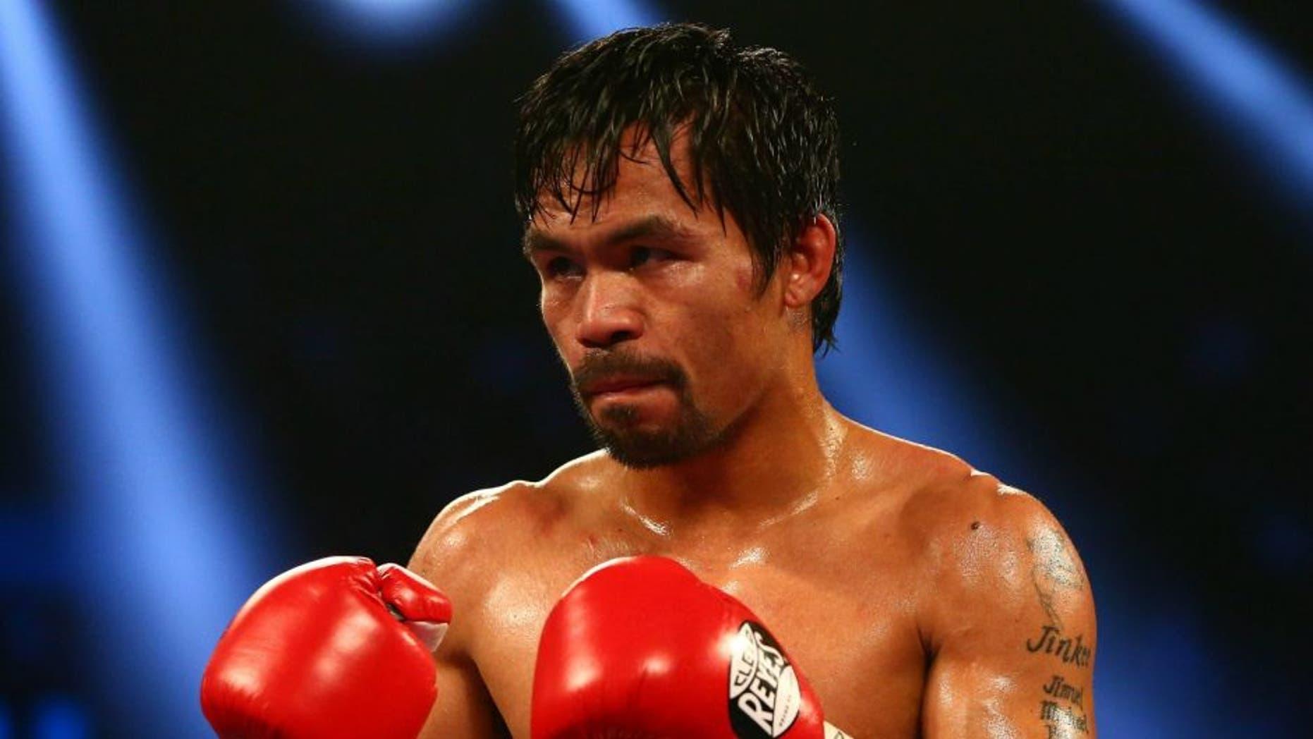 April 9, 2016; Las Vegas, NV, USA; Manny Pacquiao fights against Timothy Bradley at MGM Grand Garden Arena. Mandatory Credit: Mark J. Rebilas-USA TODAY Sports