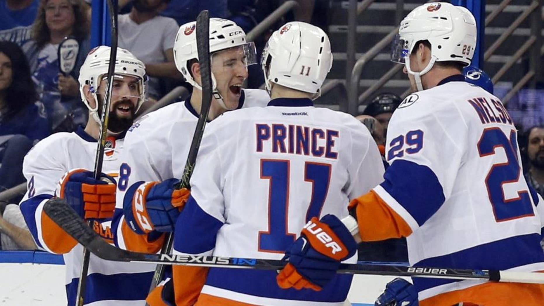 TAMPA, FL - APRIL 27: Shane Prince #11 of the New York Islanders is congratulated on his goal by teammates Nick Leddy #2, Ryan Strome #18 and Brock Nelson #29 against the Tampa Bay Lightning during the first period in Game One of the Eastern Conference Second Round during the 2016 NHL Stanley Cup Playoffs at Amalie Arena on April 27, 2016 in Tampa, Florida. (Photo by Mike Carlson/Getty Images)