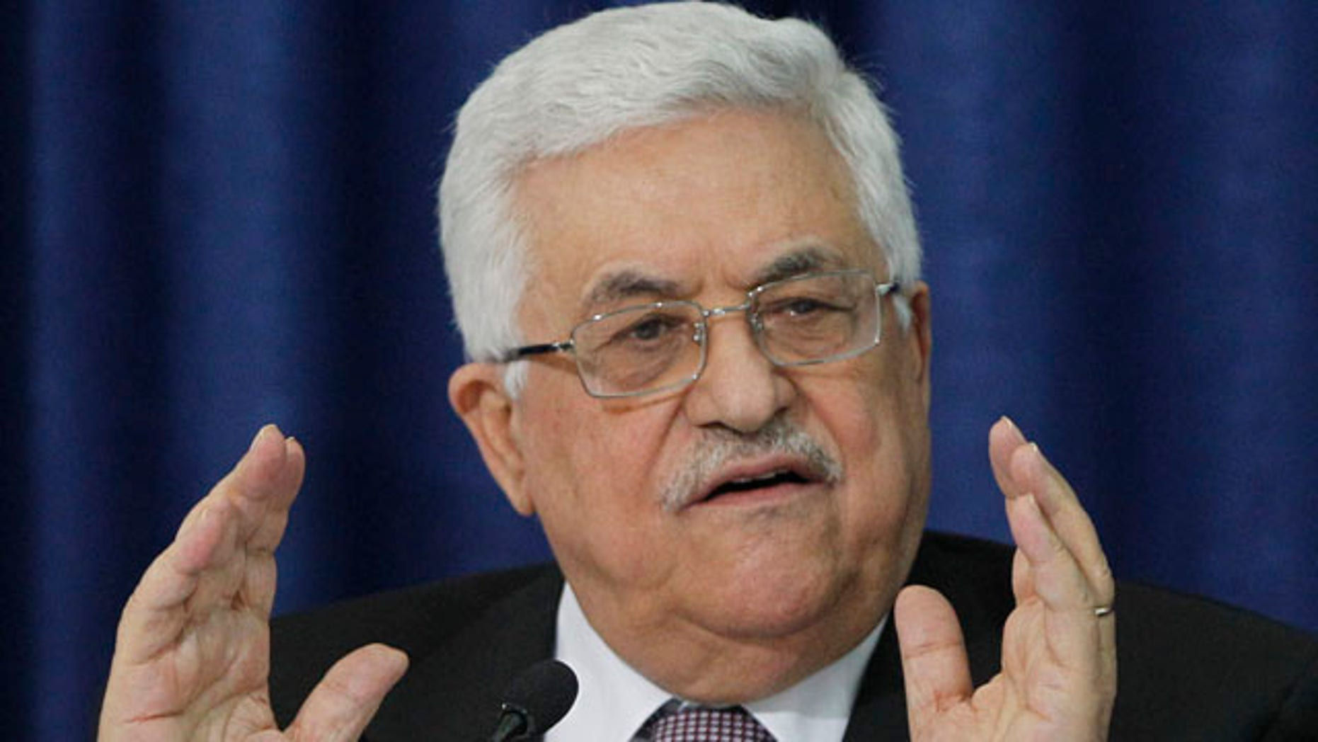 April 28: Palestinian President Mahmoud Abbas gestures as he speaks during a press conference with members of the Israeli Peace Initiative in Ramallah.