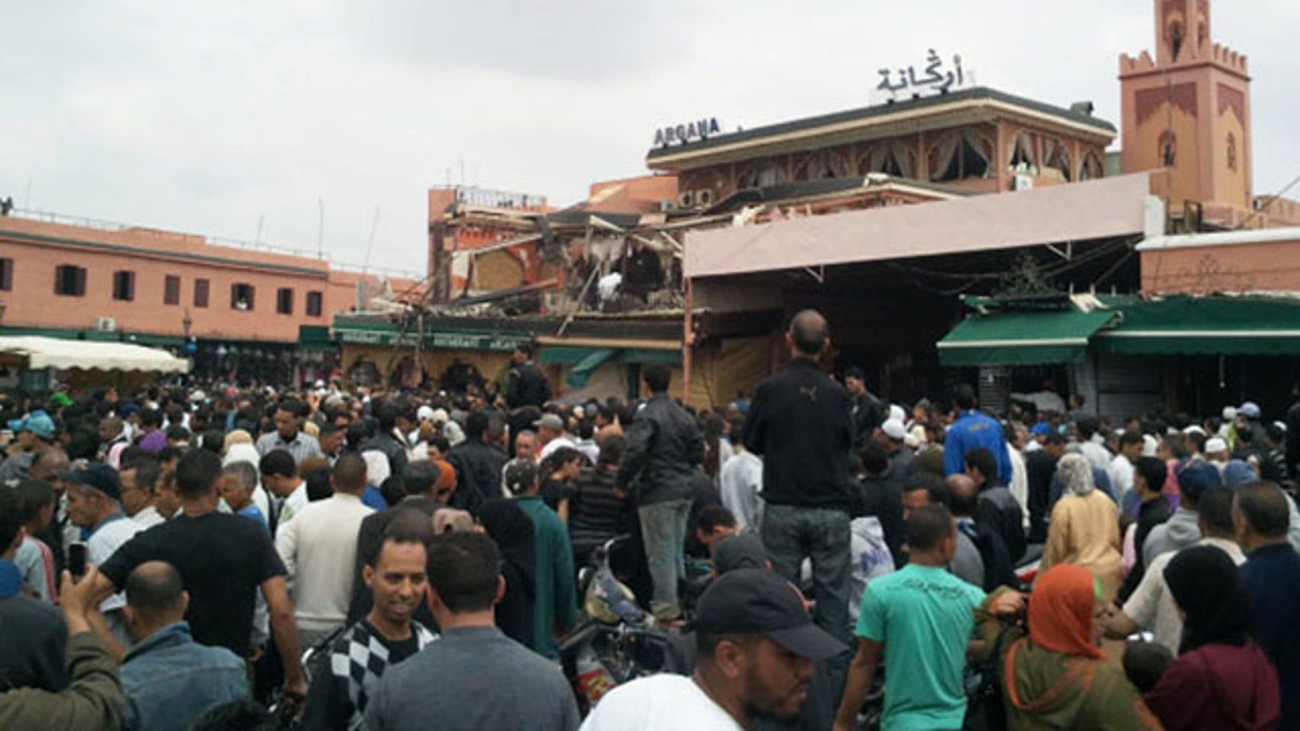 April 28: A crowd congregates outside a cafe in Marrakech. Morocco.
