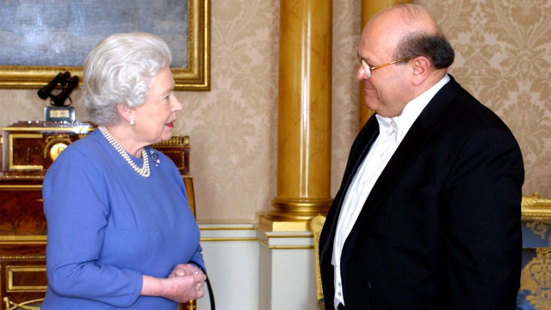 In this March 3, 2005, file photo, Queen Elizabeth II receives the Ambassador of Syria, Sami Khiyami, at Buckingham Palace, London.