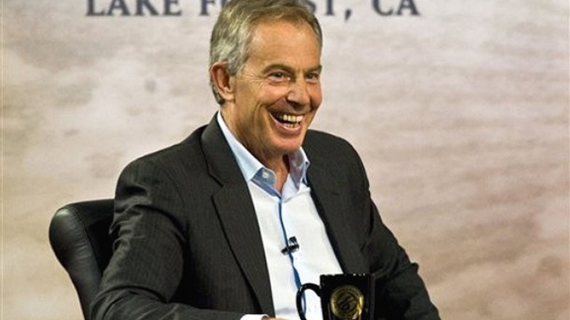 March 6: Former British Prime Minister Tony Blair laughs while talking with Pastor Rick Warren during the 'Civil Forum on Peace In a Globalized Economy' at Saddleback Church in Lake Forest, Calif.