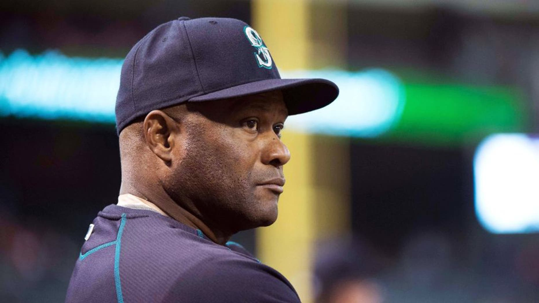 Apr 27, 2015; Arlington, TX, USA; Seattle Mariners manager Lloyd McClendon (21) watches his team take on the Texas Rangers at Globe Life Park in Arlington. Mandatory Credit: Jerome Miron-USA TODAY Sports