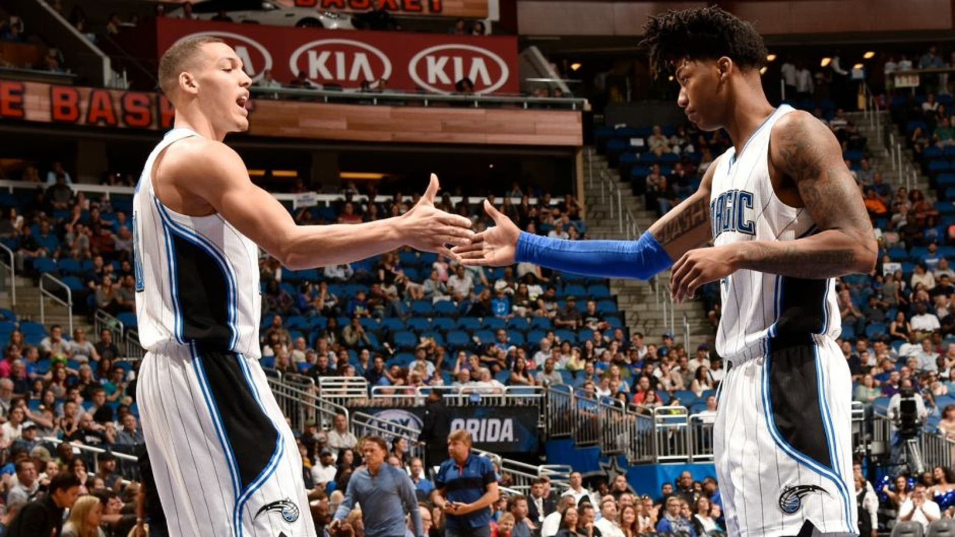 ORLANDO, FL - APRIL 3: Elfrid Payton #4 of the Orlando Magic shakes hands with Aaron Gordon #00 of the Orlando Magic during the game against the Memphis Grizzlies on April 3, 2016 at Amway Center in Orlando, Florida. NOTE TO USER: User expressly acknowledges and agrees that, by downloading and or using this photograph, User is consenting to the terms and conditions of the Getty Images License Agreement. Mandatory Copyright Notice: Copyright 2016 NBAE (Photo by Fernando Medina/NBAE via Getty Images)