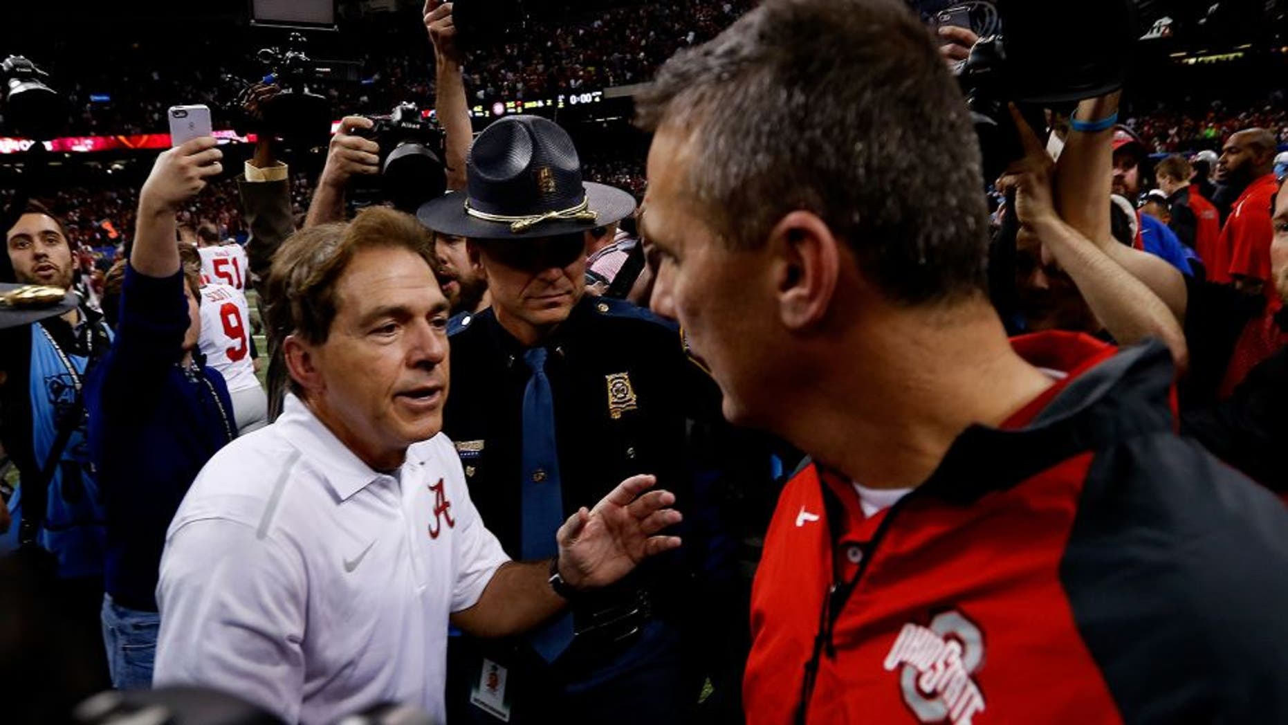 NEW ORLEANS, LA - JANUARY 01: Head coach Urban Meyer (R) of the Ohio State Buckeyes shakes hands with head coach Nick Saban (L) of the Alabama Crimson Tide after the All State Sugar Bowl at the Mercedes-Benz Superdome on January 1, 2015 in New Orleans, Louisiana. The Ohio State Buckeyes defeated the Alabama Crimson Tide 42 to 35. (Photo by Sean Gardner/Getty Images)